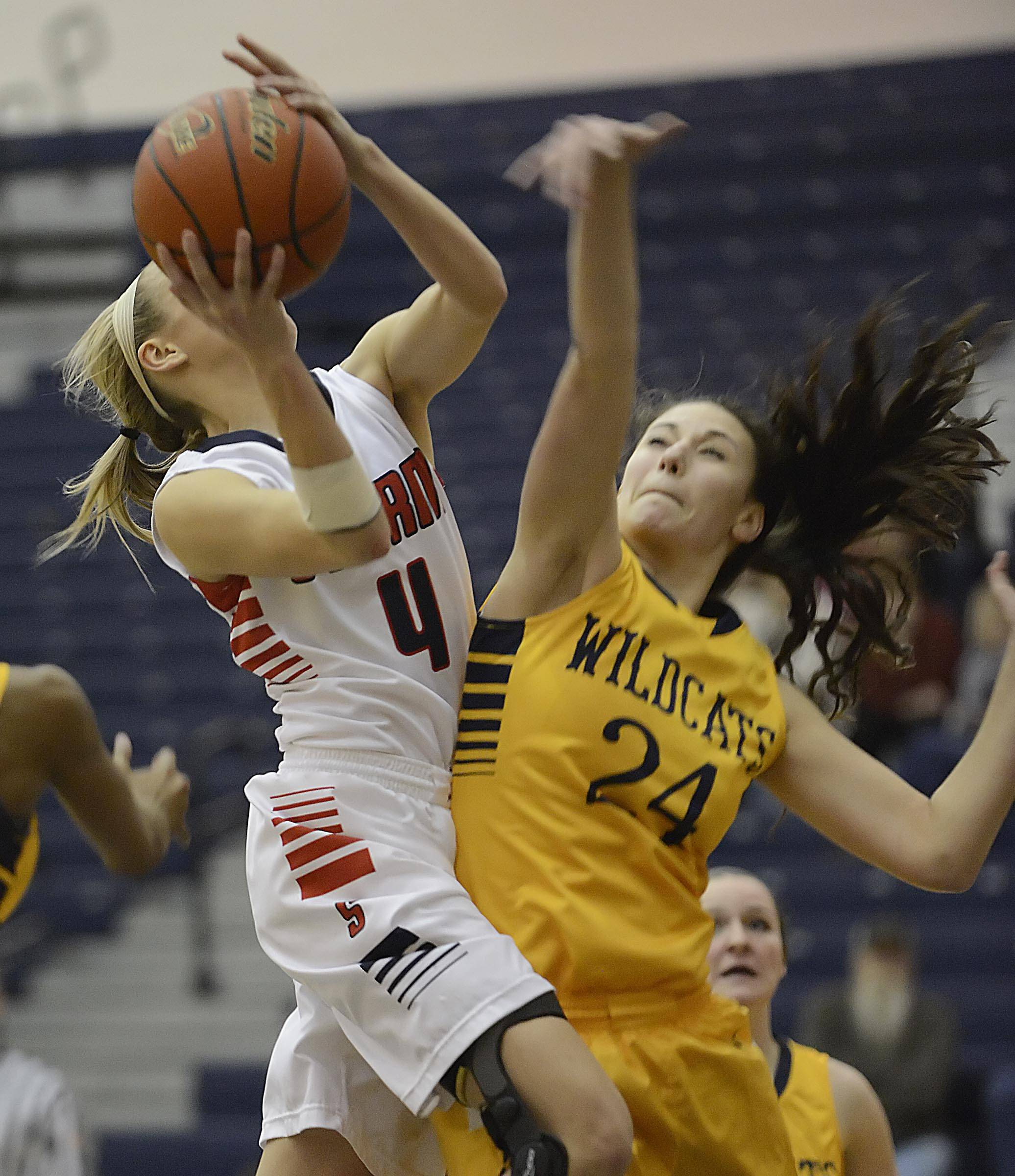 South Elgin's Savanah Uvegas is fouled by Neuqua Valley's Bryce Menendez Monday in South Elgin.