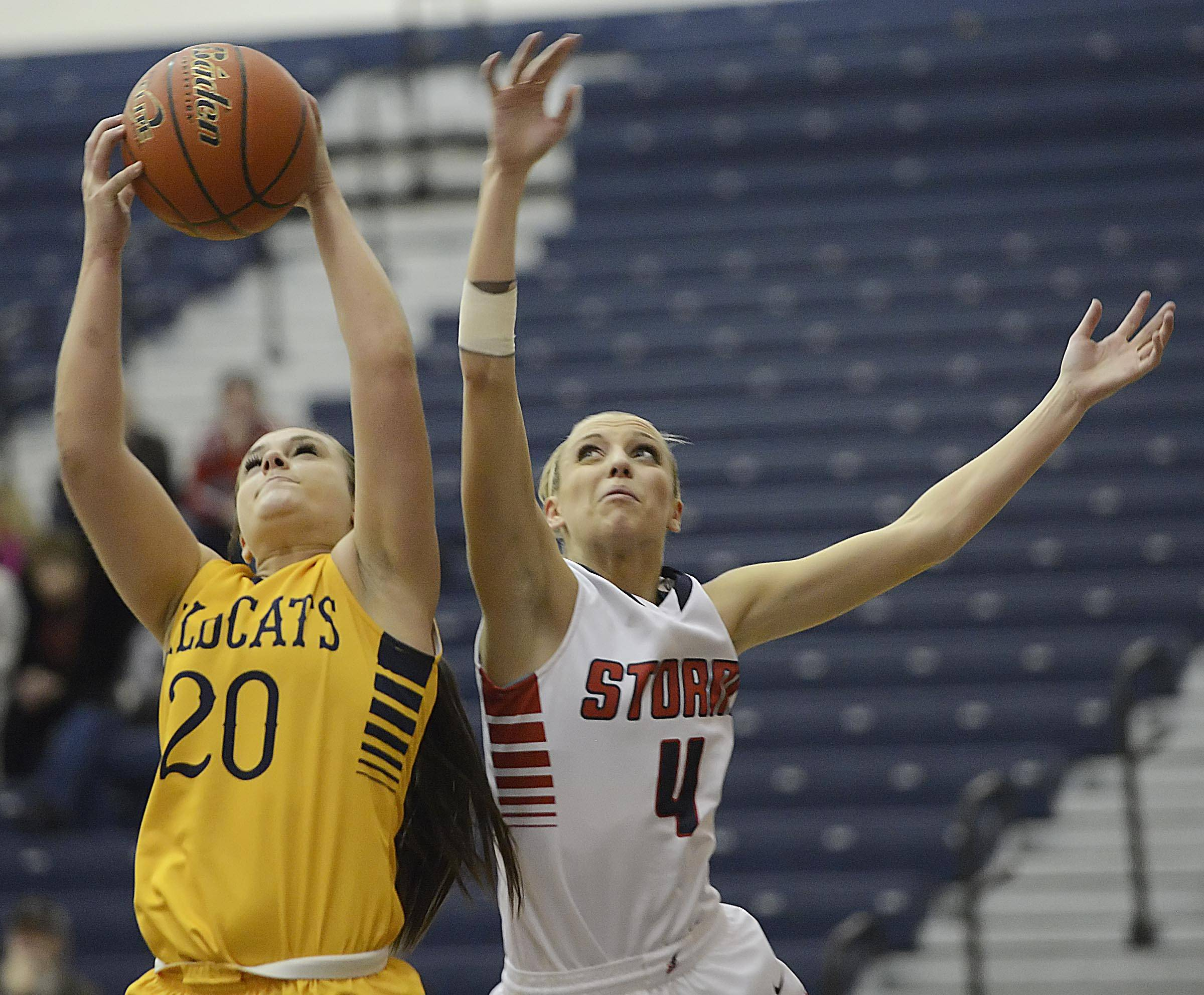 Neuqua Valley's Niki Lazar takes a rebound from South Elgin's Savanah Uvegas Monday in South Elgin.