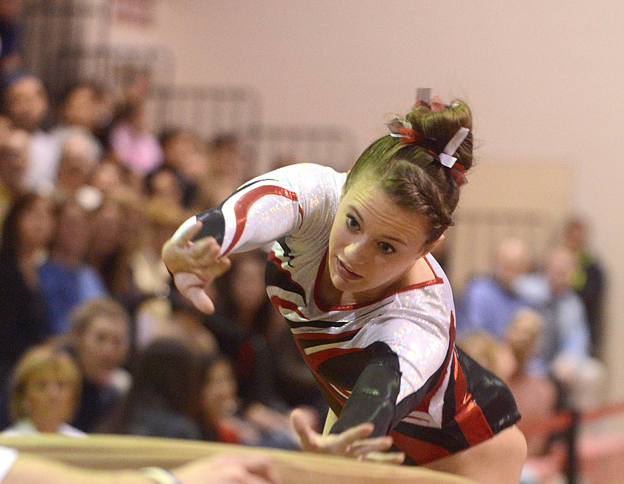 Barrington's Molly Blanke competes in the vault during the girl's regional gymnastics meet in Barrington on Monday.