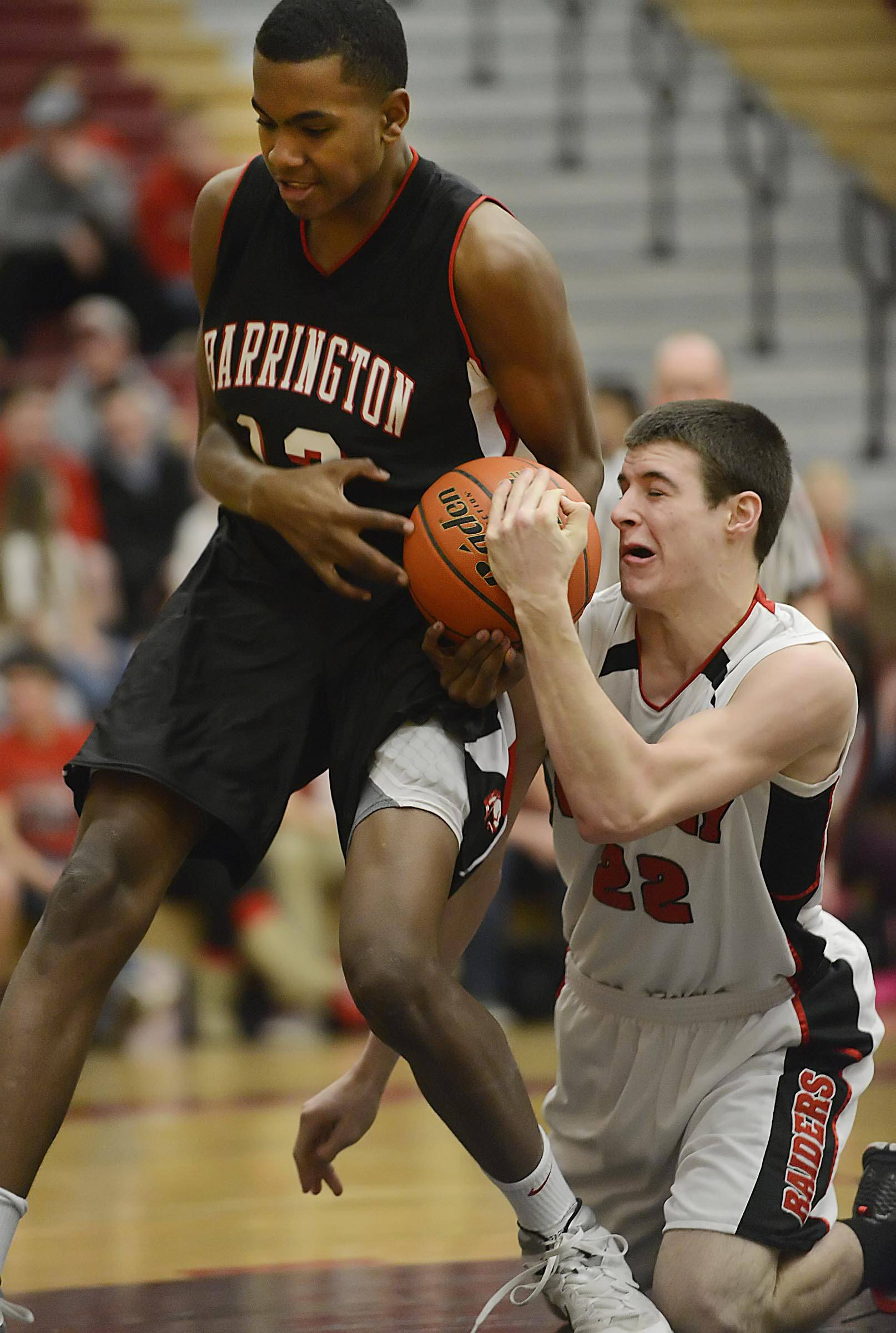 Huntley's Connor Boesch, right, and Barrington's Chris Lester battle for the ball Tuesday in Huntley.