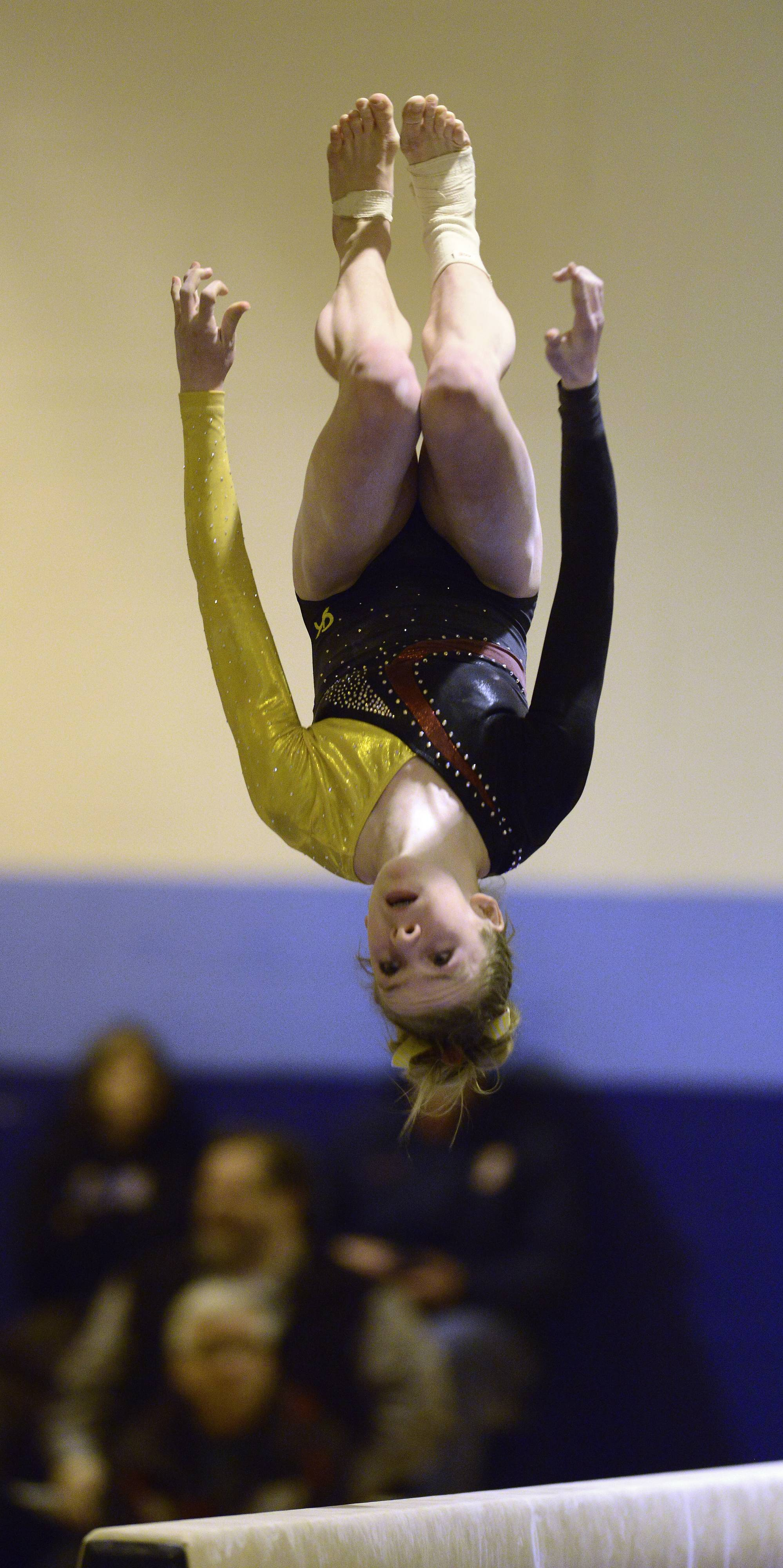 Schaumburg's Alyssa Kiszka competes on the balance beam during Tuesday's regional gymnastics meet in Mount Prospect.