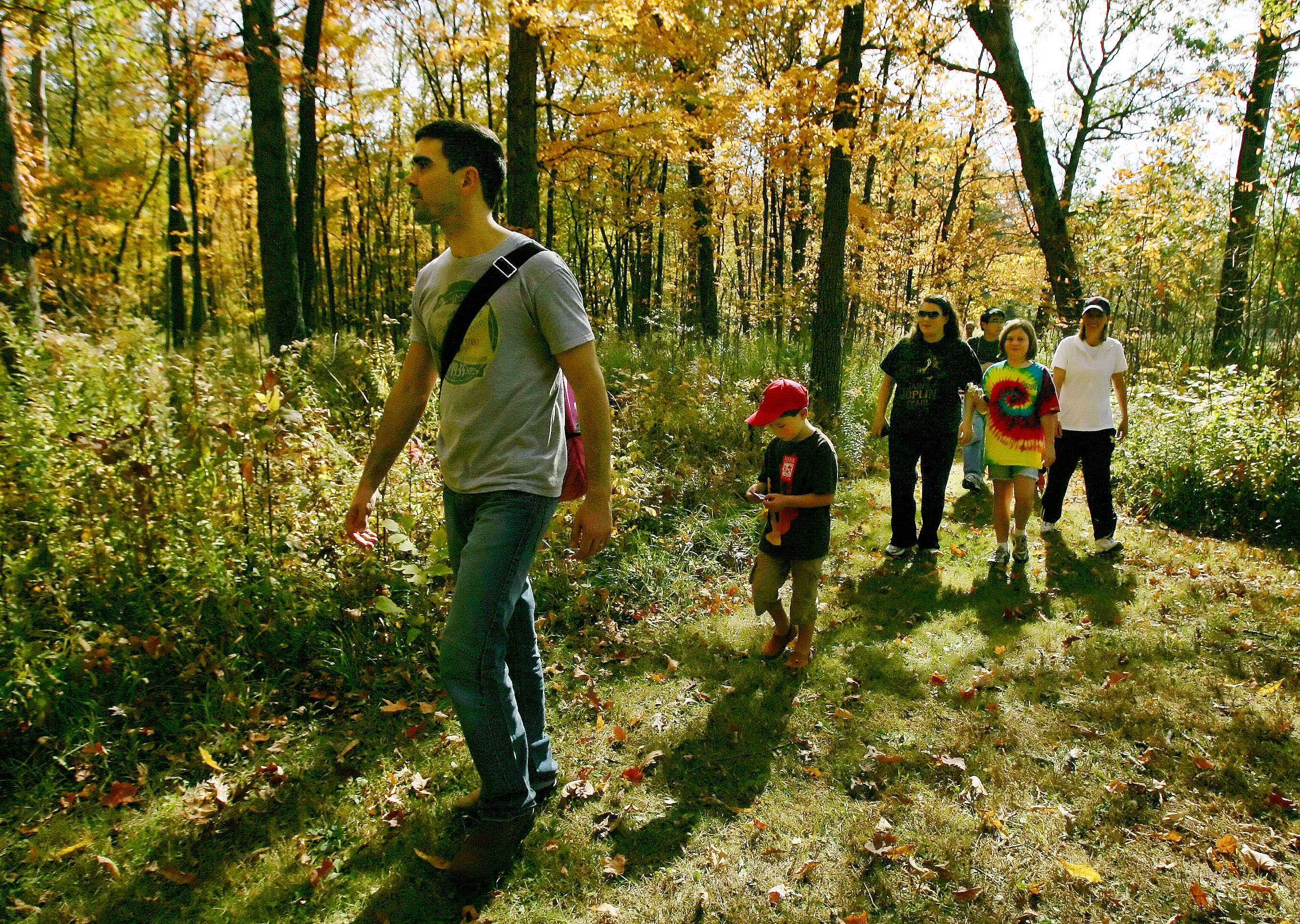 Families take a nature hike in Ryerson Conservation Area during a Lake County Forest Preserve District Fall Festival. The LCFPD recently approved a 100-year plan for the management of Lake County's forests.