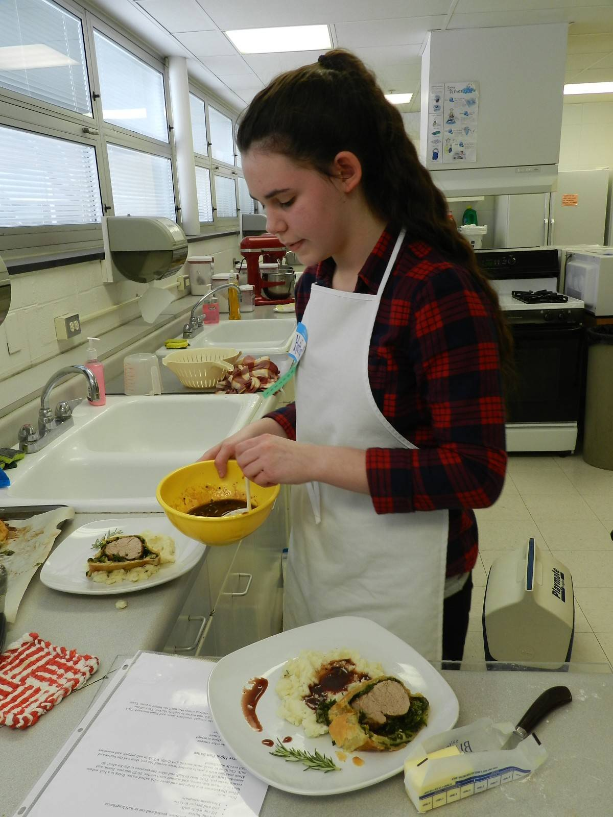 Kaitlyn Ball of Arlington Heights won first place in the age 13 and over category for her pork Florentine en croute with rosemary mashed potatoes at a favorite foods contest in Arlington Heights sponsored by 4-H.