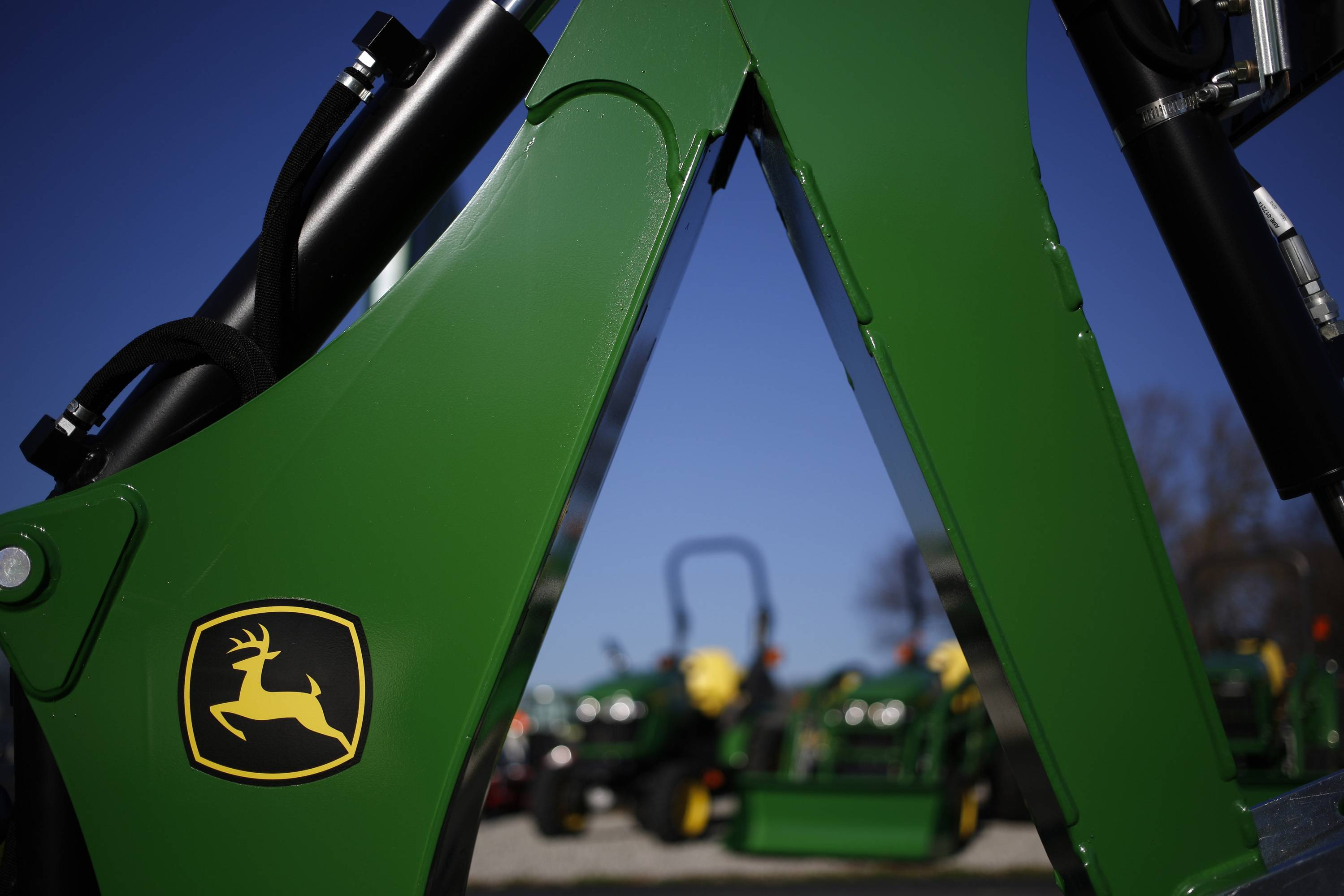 Deere & Co. says its first-quarter net income rose almost 5 percent, but it projected a slowdown in sales of farm equipment this year.