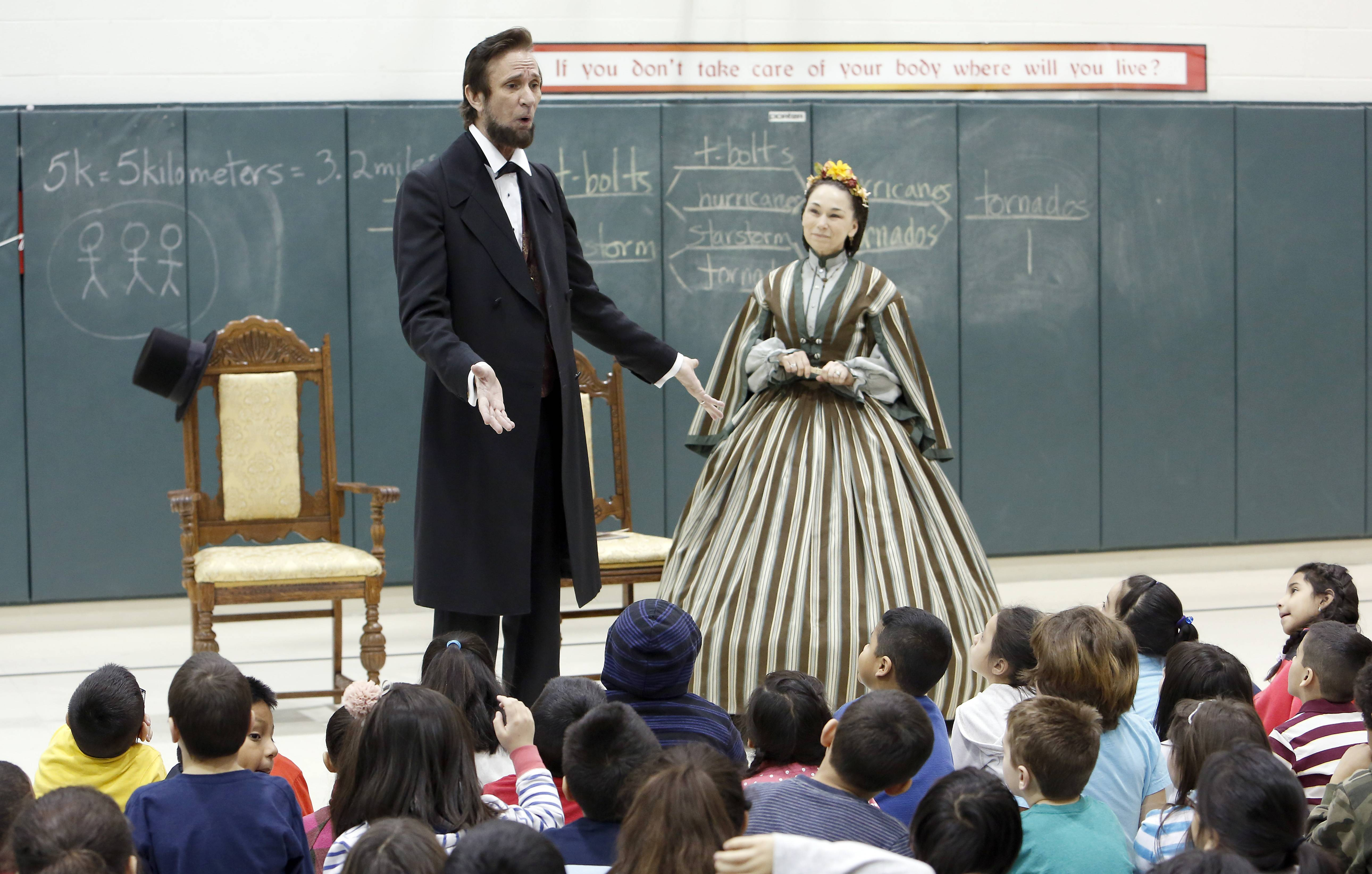 Michael Krebs and Debra Ann Miller portray Abraham and Mary Todd Lincoln Wednesday during a series of programs at Lincoln Elementary School in Hoffman Estates.