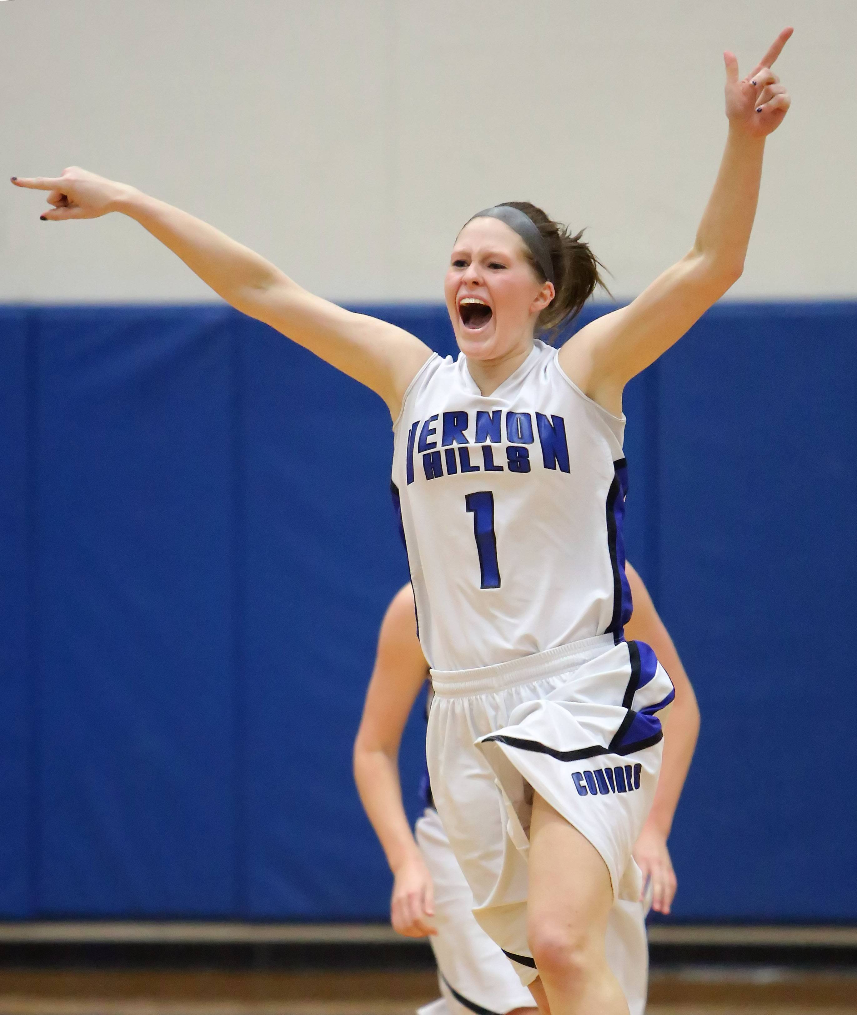 Vernon Hills' Sydney Smith celebrates after the Cougars' last-minute win over Zion-Benton in the North Suburban Conference championship game Wednesday night at Vernon Hills.