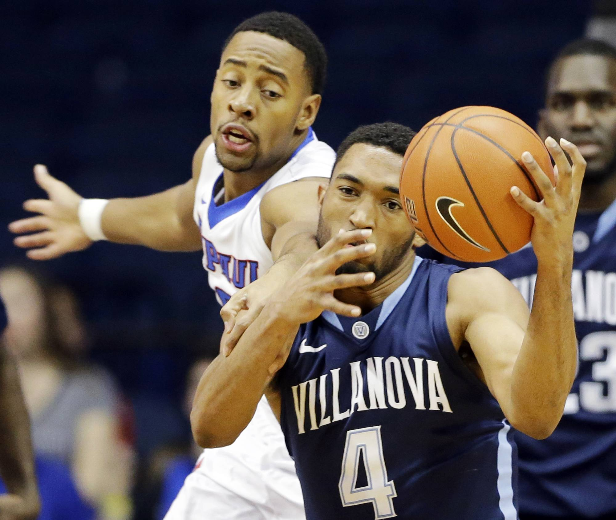 Villanova guard Darrun Hilliard (4) rebounds the ball against DePaul guard R.J. Curington during Wednesday night's game in Rosemont.
