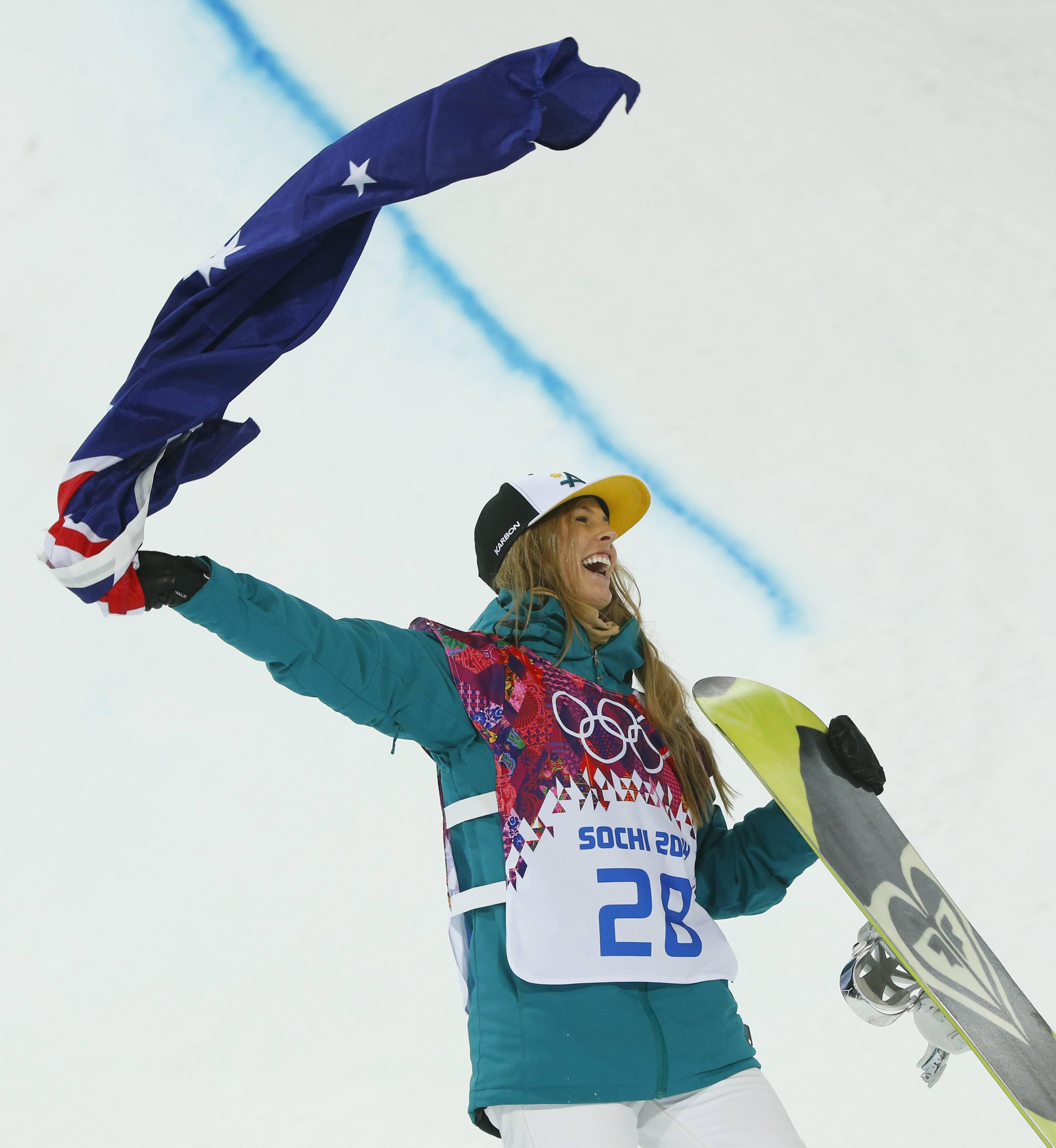 Australia's Torah Bright celebrates her silver medal in the women's snowboard halfpipe final at the Rosa Khutor Extreme Park, at the 2014 Winter Olympics, Wednesday, Feb. 12, 2014, in Krasnaya Polyana, Russia. (AP Photo/Sergei Grits)