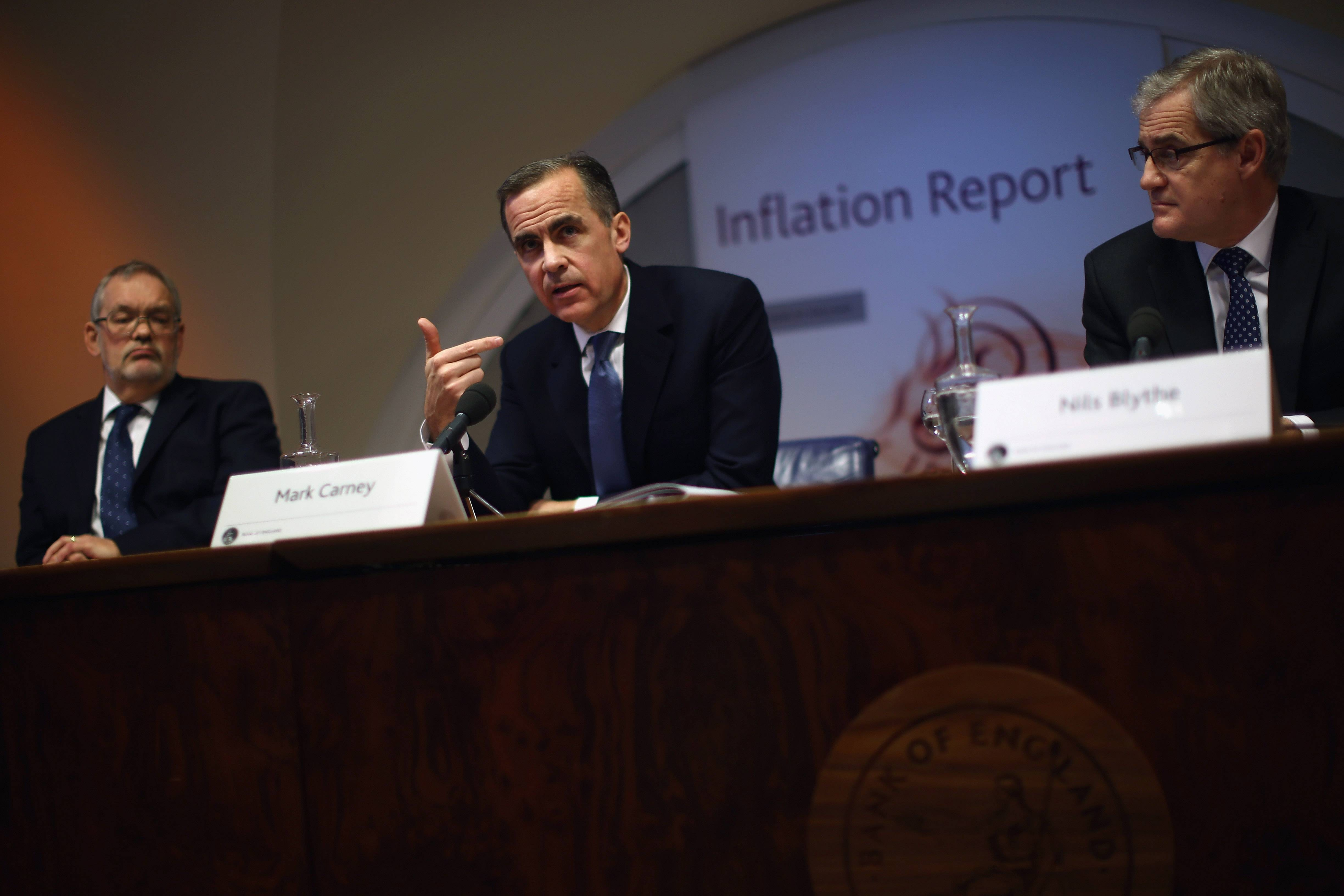 Bank of England Governor Mark Carney, center, speaks during the bank's inflation report news conference in London, England,n Wednesday.