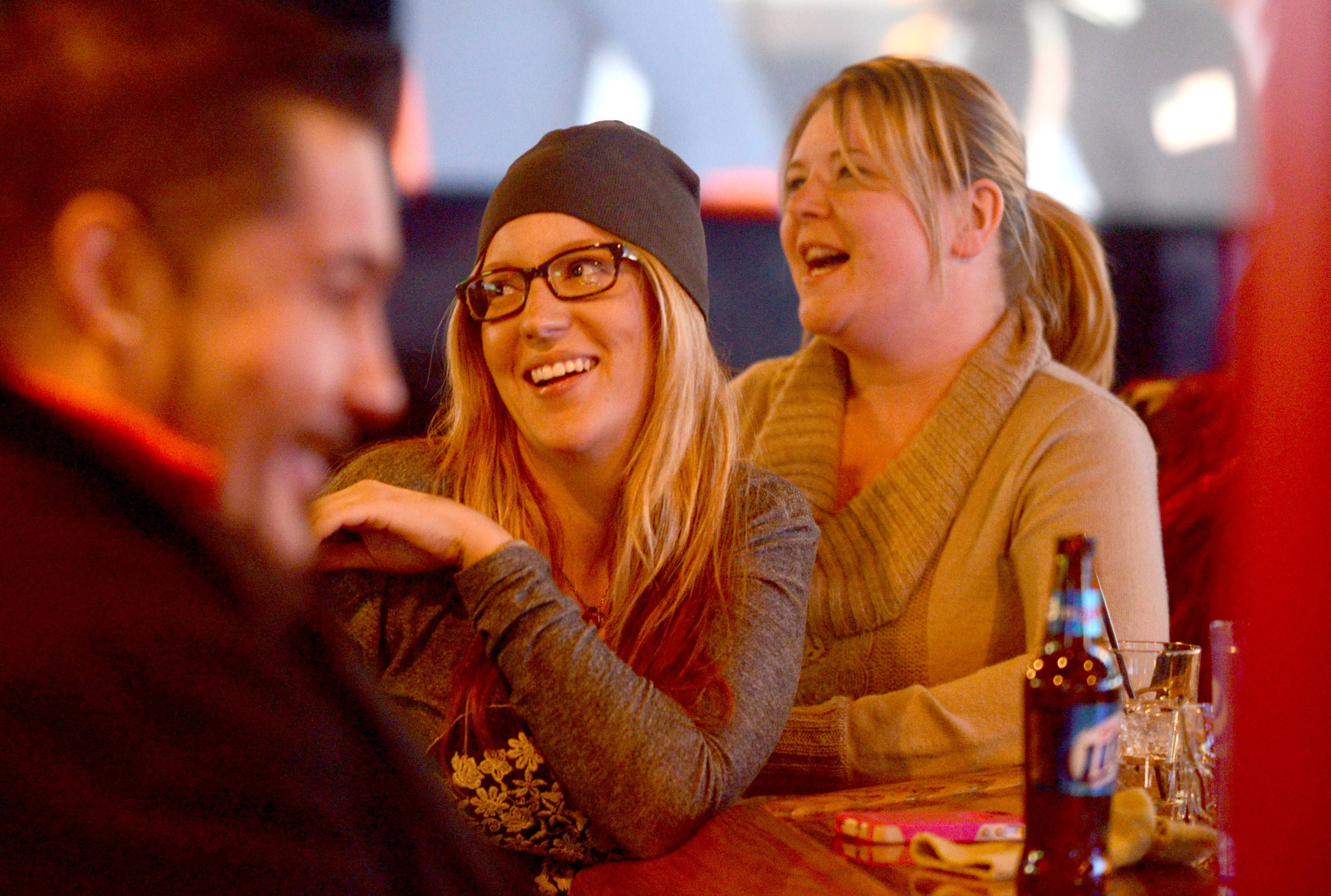 Samantha Reuter, center, of Chicago, shares a laugh with Jill Ramirez, right, of Hoffman Estates at M T Barrels in Schaumburg.