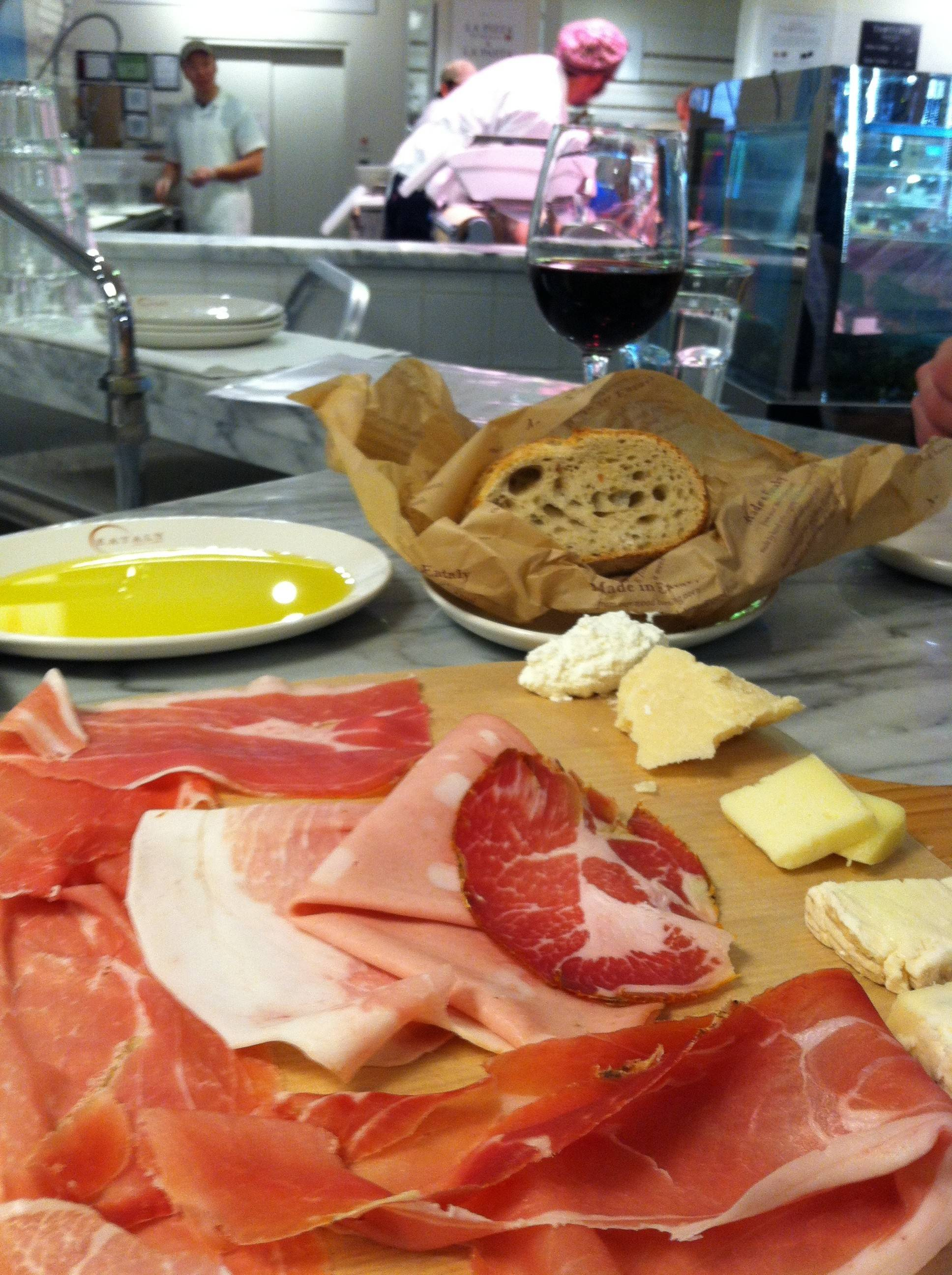 Refuel for more shopping with a glass of wine and a proscuitto platter at Eataly in Chicago.