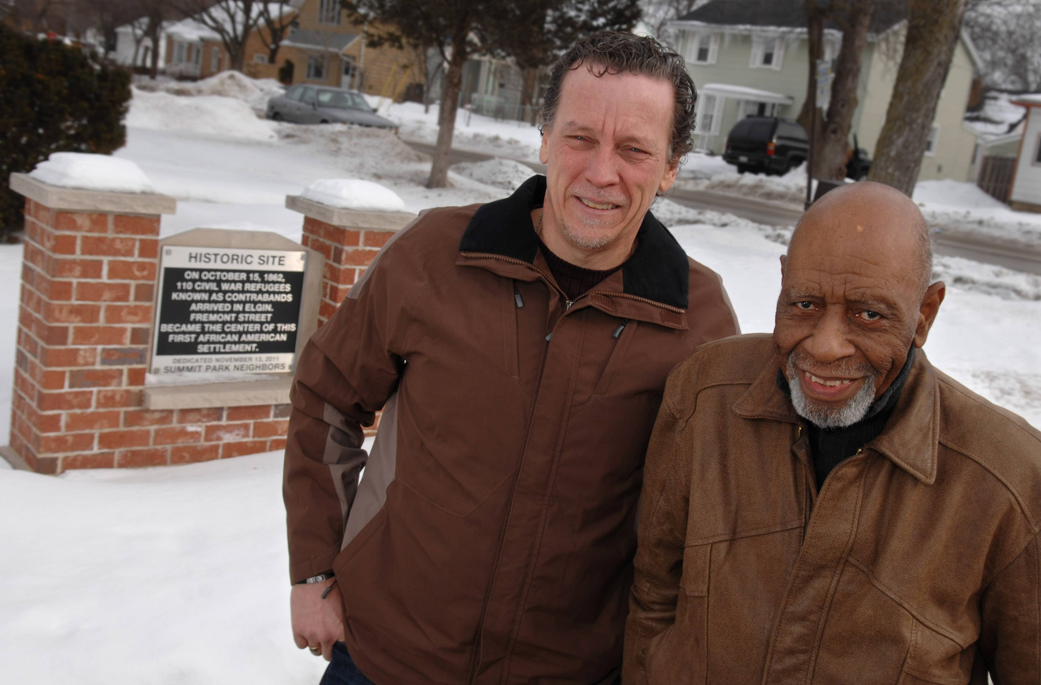 Phil Broxham, president of Elgin-based Grindstone Video Productions, left, is working with longtime Elgin resident Ernie Broadnax on a documentary about the history of blacks in Elgin.