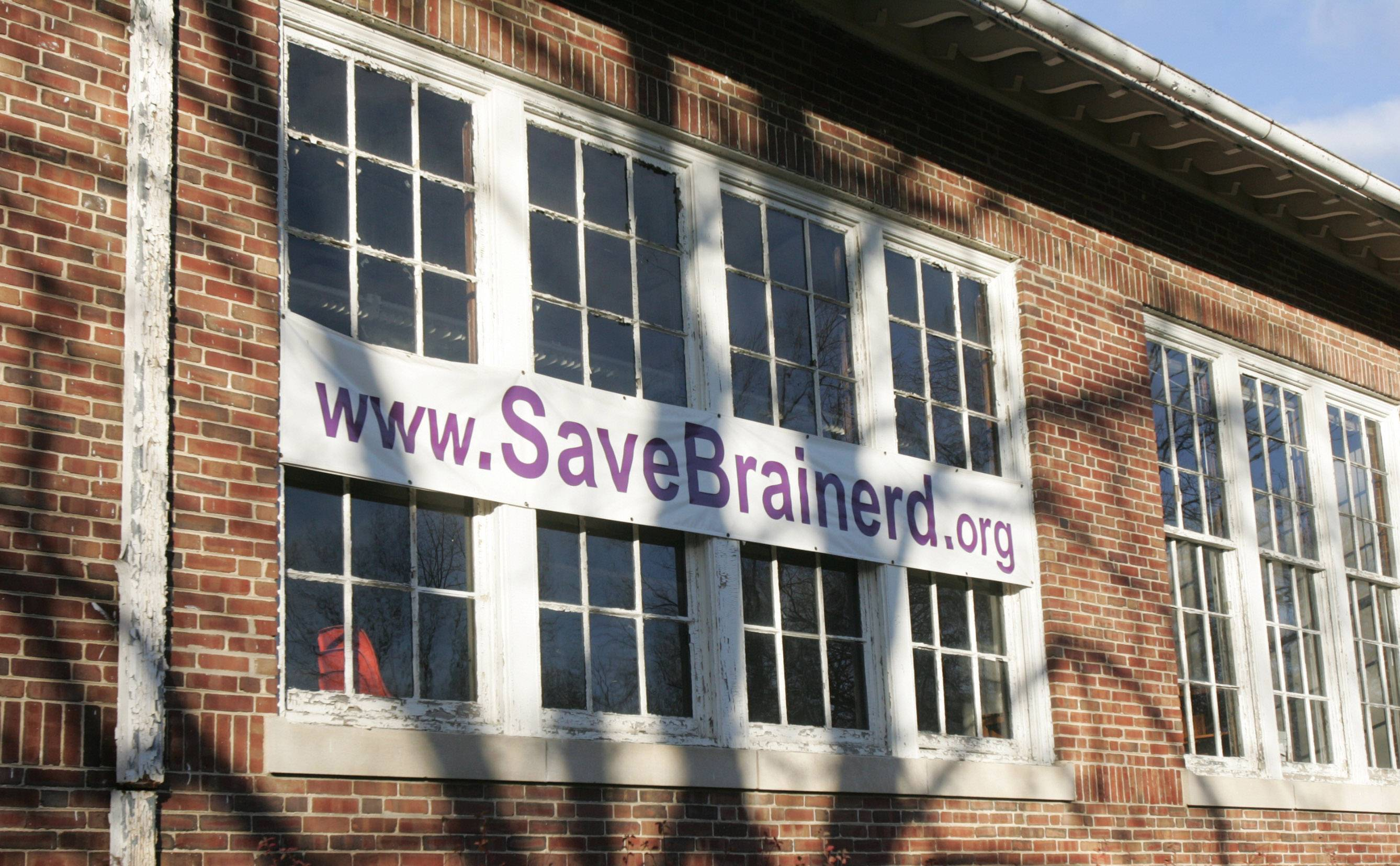 This sign on the Brainerd building in Libertyville will be removed and replaced with one without the word 'save'.
