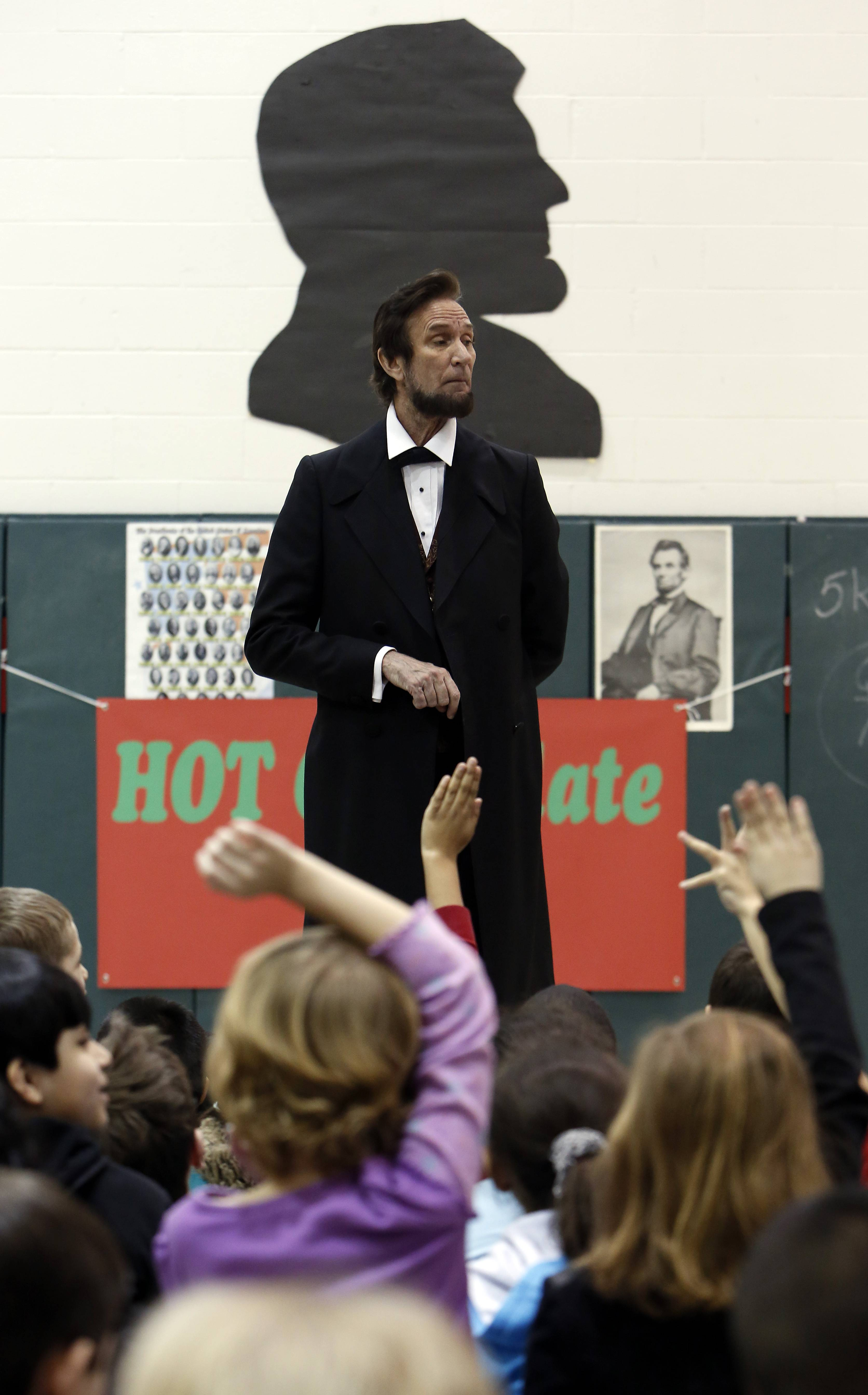 Michael Krebs portrays President Lincoln during a program for students Wednesday at Lincoln Elementary School in Hoffman Estates.