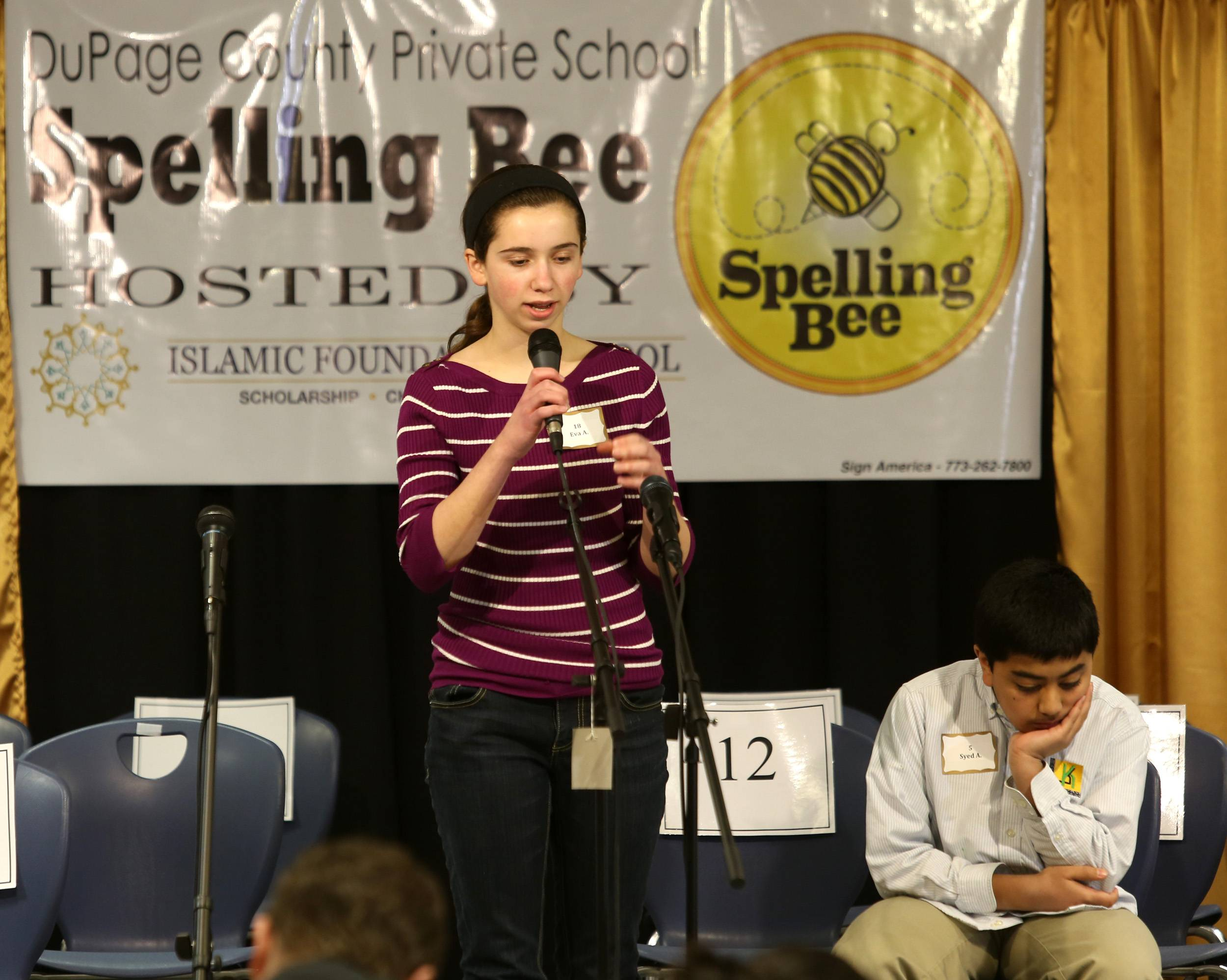 Eva Analitis of St. Raphael Catholic School in Naperville gets her word right to advance to the next round in the Scripps National Spelling Bee competition.