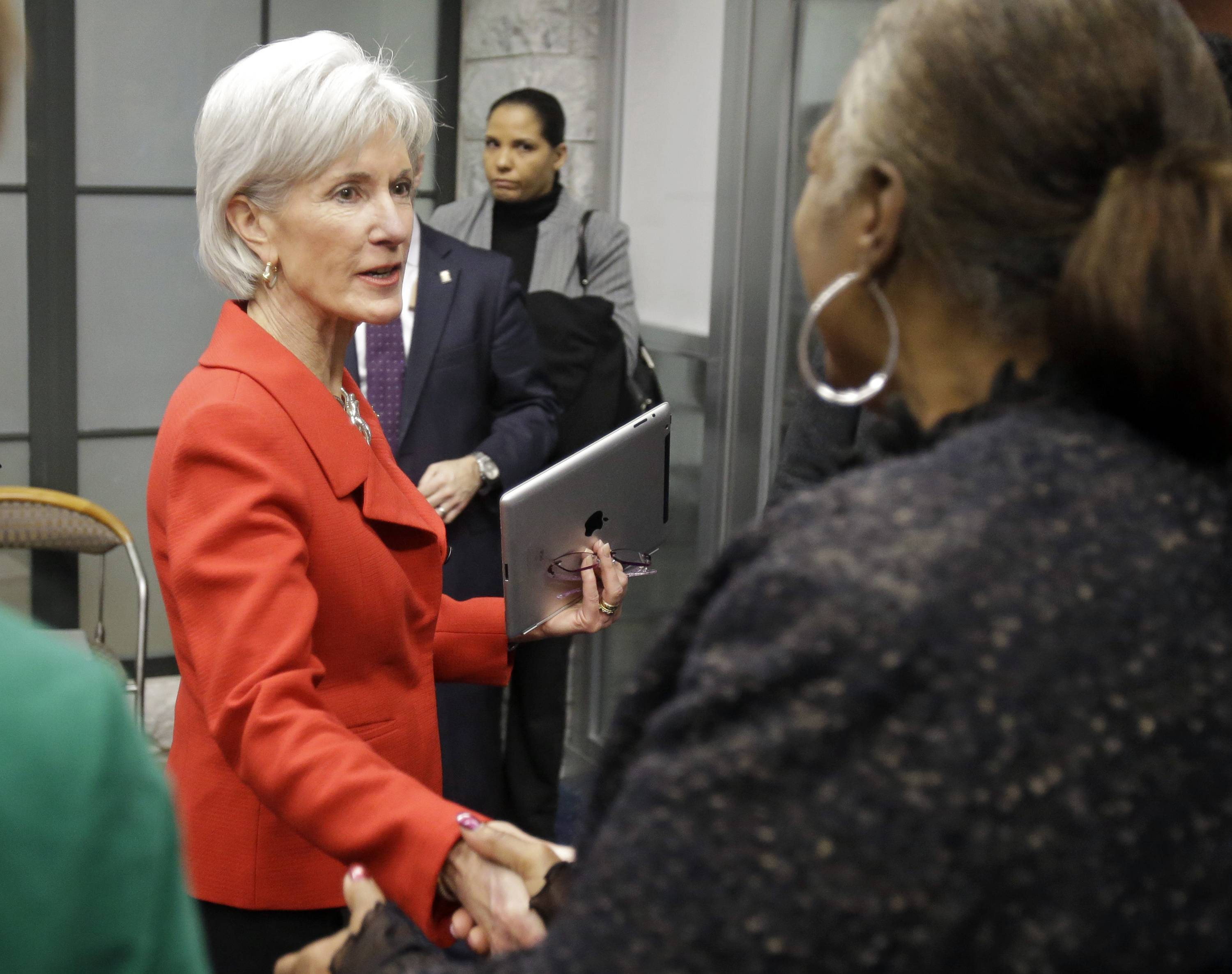 Health and Human Services Secretary Kathleen Sebelius greets visitors after a news conference on enrollment in affordable health coverage in Cleveland on Feb. 3. New numbers released Tuesday show nearly 3.3 million people signed up through Feb. 1.
