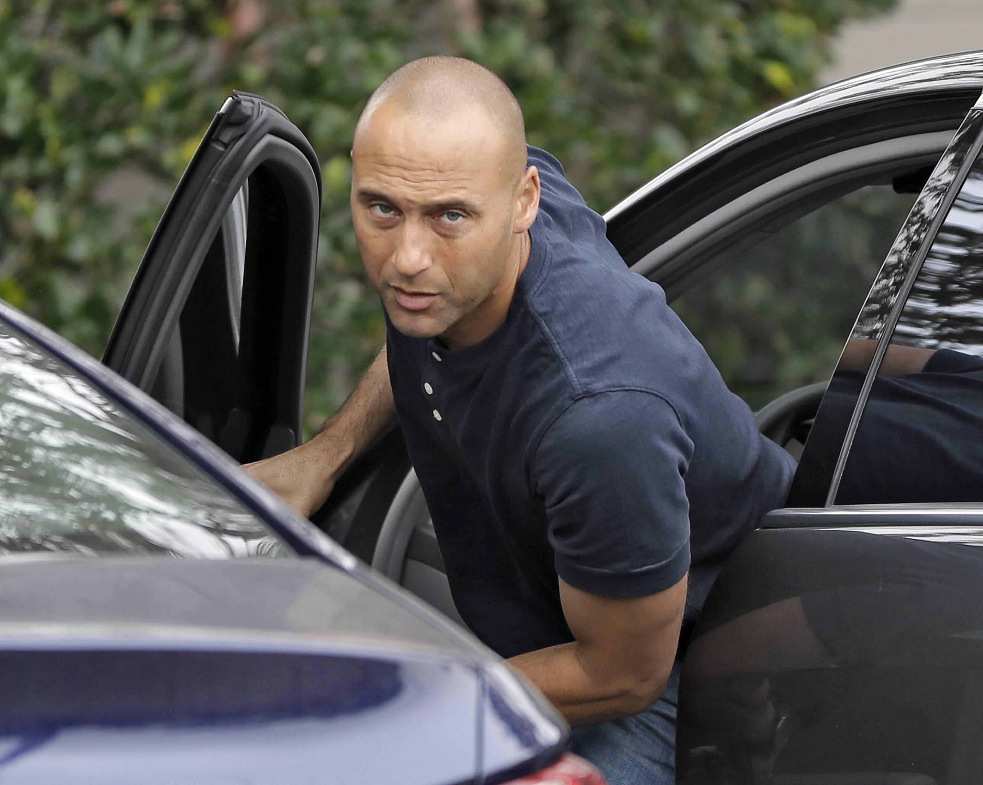 New York Yankees shortstop Derek Jeter arrives for a workout at the Yankees' minor league facility Wednesday in Tampa, Fla. Jeter says he will retire after this season. Jeter posted a long letter on his Facebook account Wednesday saying the 2014 will be his last year playing professional baseball.
