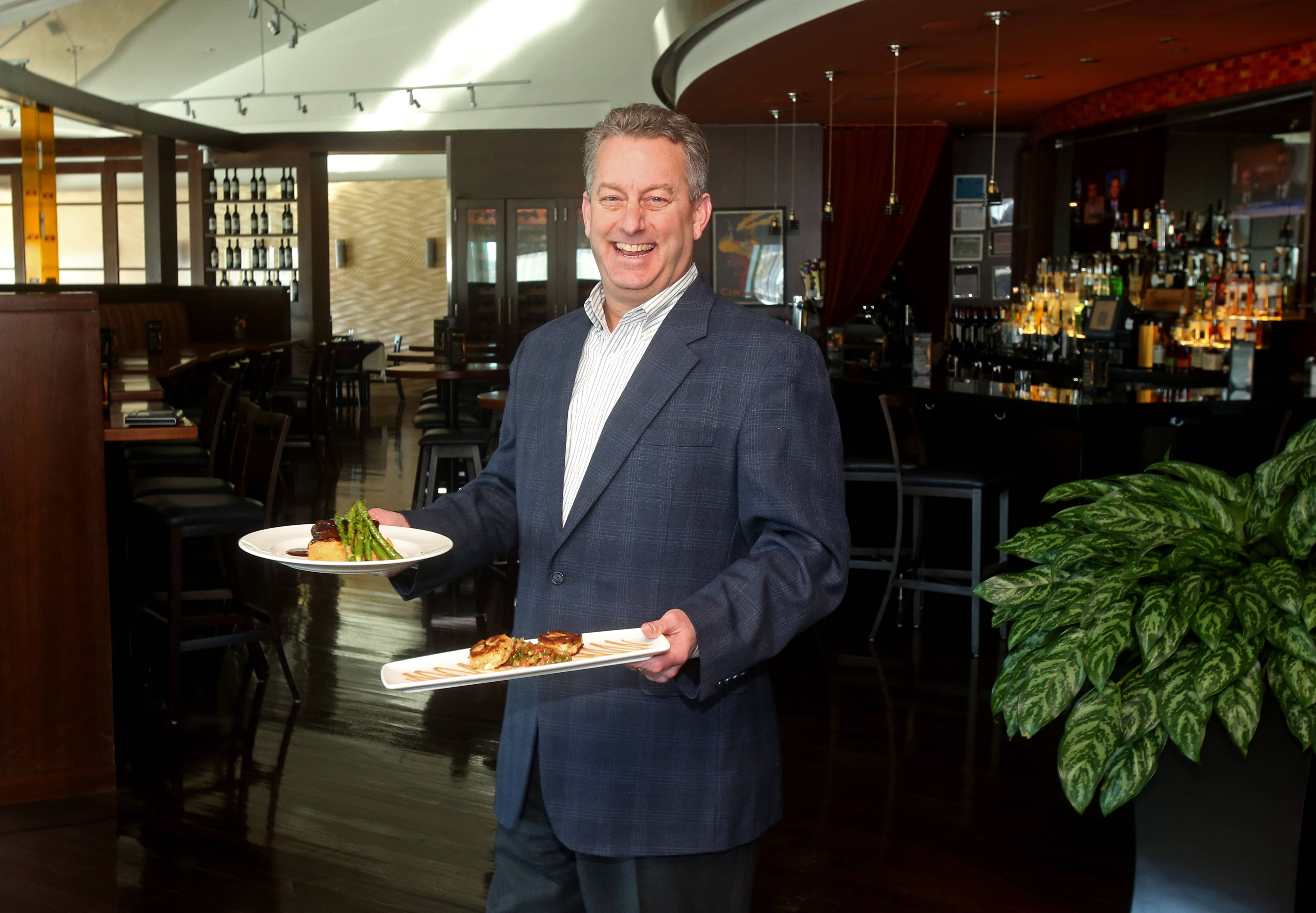 CityGate Grille, where Ray Kinney, chairman of the Dine Naperville committee, is seen about to enjoy a meal, is one of 34 restaurants participating in the first Naperville Restaurant Week from Feb. 16 to March 3.