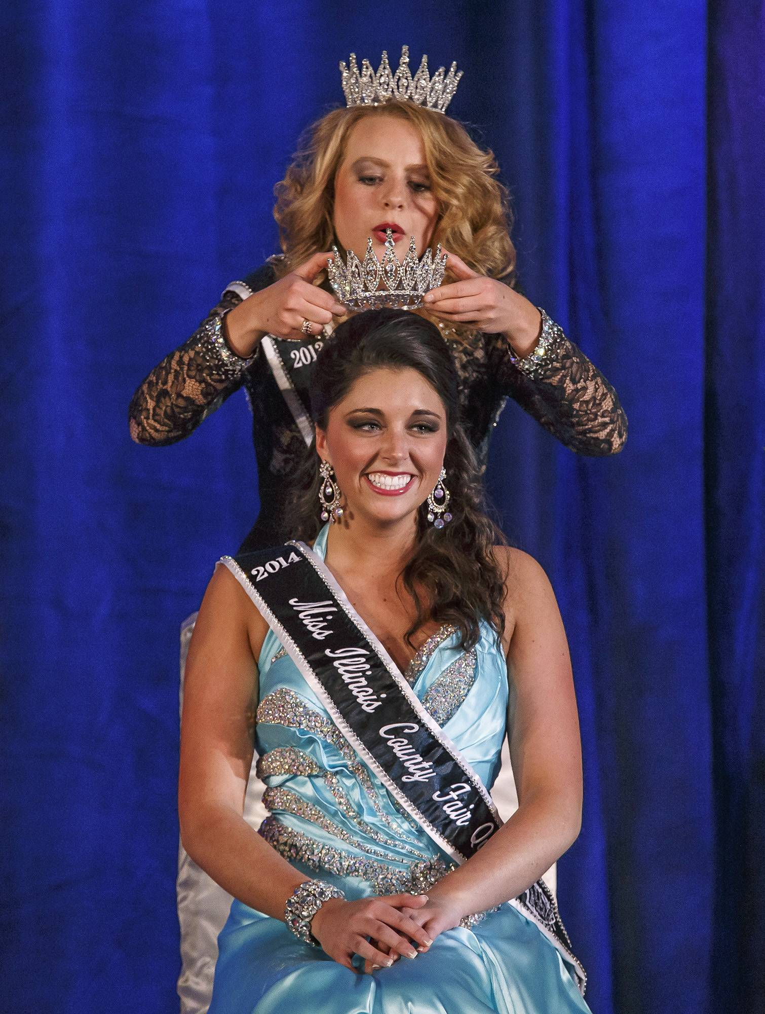 WisconsinMiss Montgomery County Fair Queen Summer Robbins, of Coffeen is crowned the 2014 Miss Illinois County Fair Queen by Amelia Martens, Miss Illinois County Fair Queen 2013, during the pageant in Springfield.