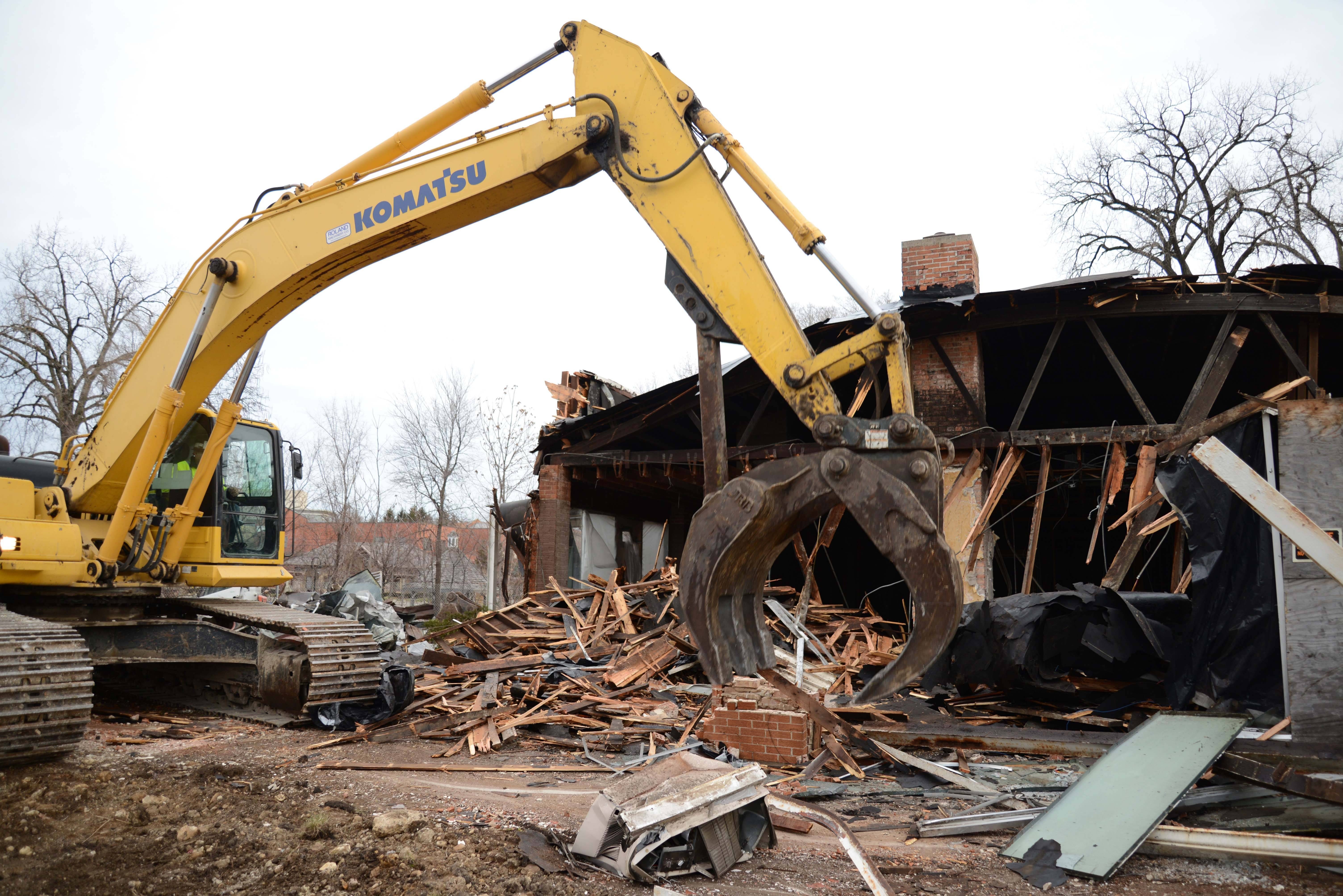 Demolition crews tore down the building at 420-440 S. Washington St. in downtown Naperville in January 2013. North Central College now plans to convert the site into a parklike setting with an electronic sign and elements to highlight the college's history of successful cross-country programs.