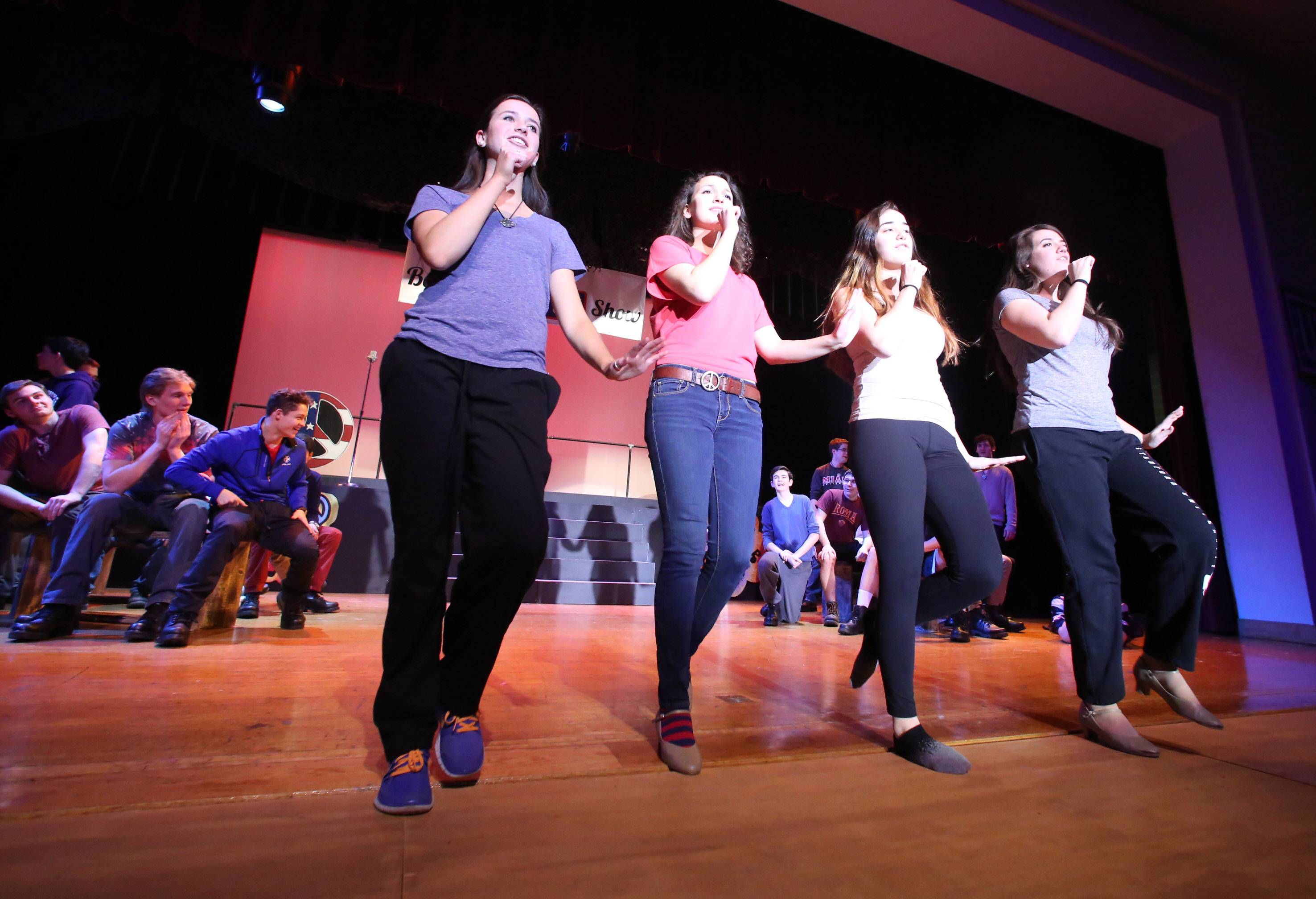 A dance routine during a rehearsal for Carmel Catholic High School's Street Scenes.