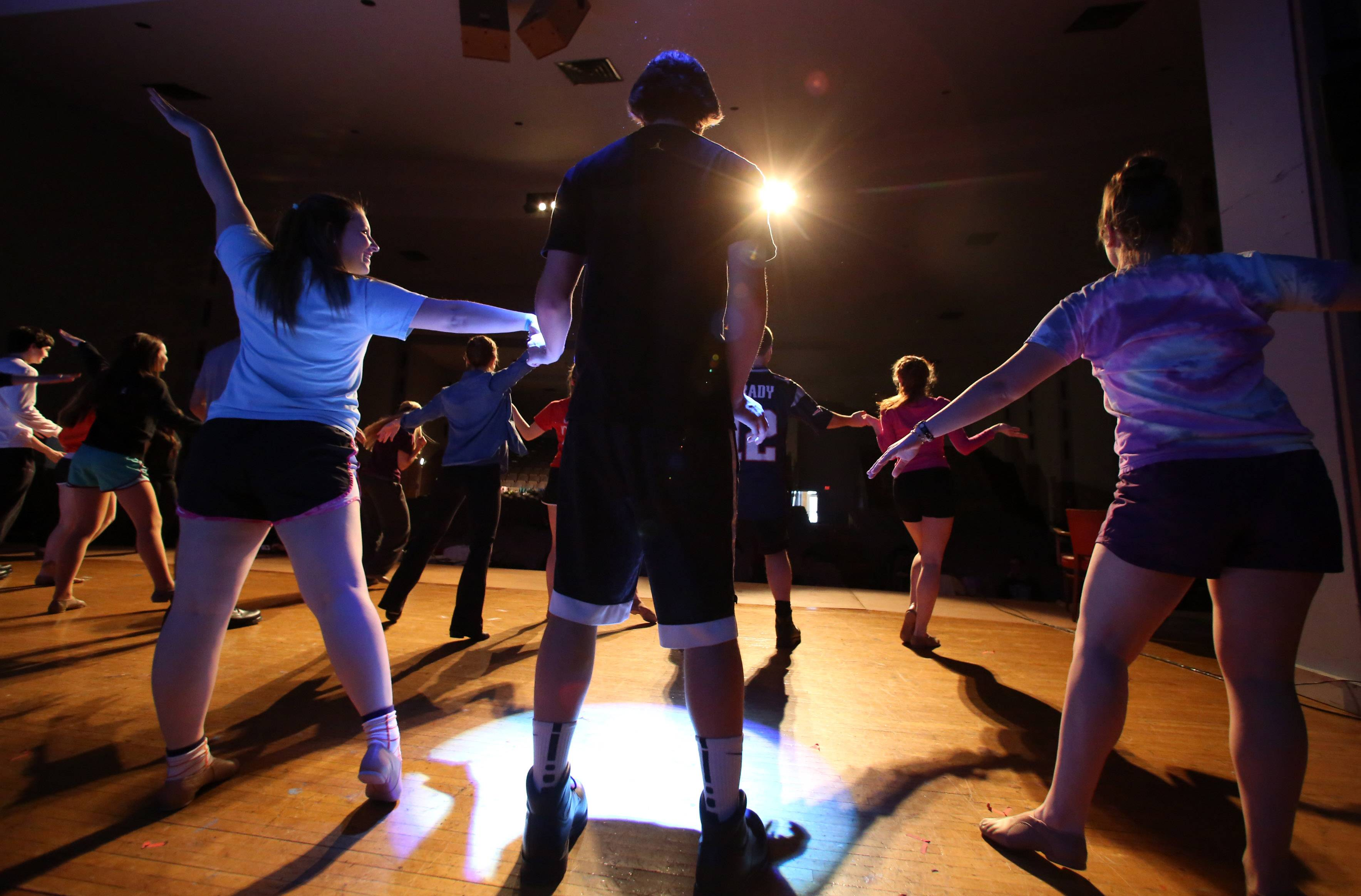 Senior Dolton Wright, center, dances with a team during a rehearsal for Carmel Catholic High School's Street Scenes.