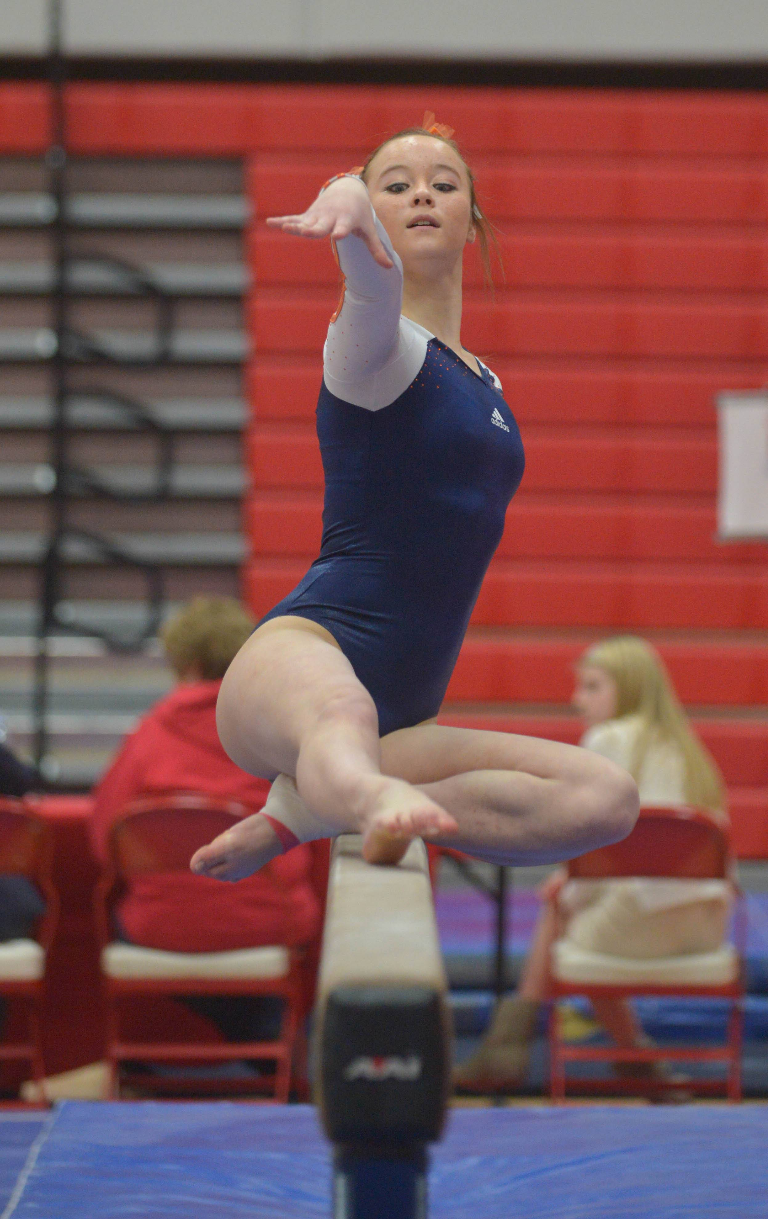 Anneli Kawaoka of Naperville North on the balance beam during the Hinsdale Central girls gymnastics sectional Wednesday.