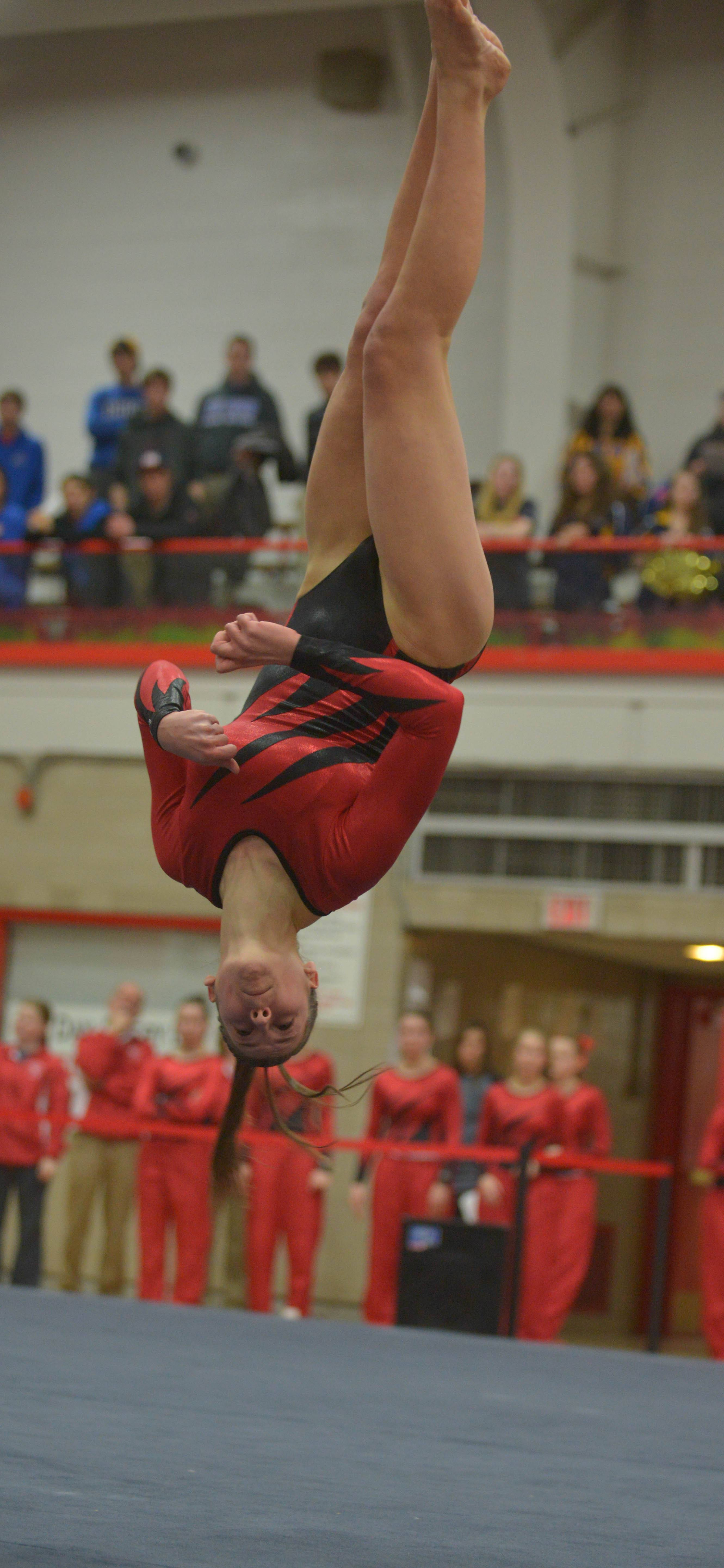 Lea Savard of Naperville Central on the floor during the Hinsdale Central girls gymnastics sectional Wednesday.