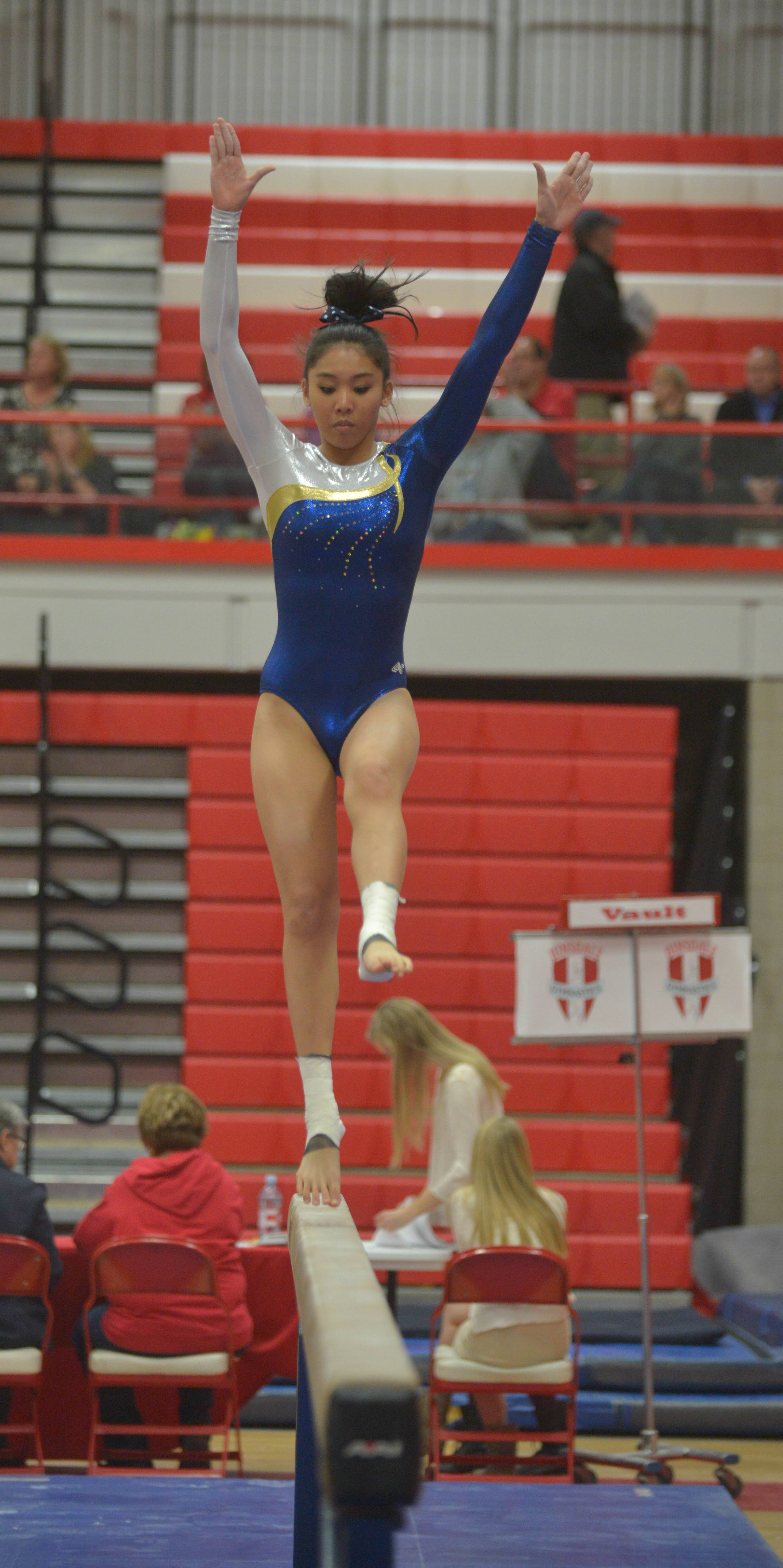Shaniah Lim of Neuqua Valley on the balance beam during the Hinsdale Central girls gymnastics sectional Wednesday.