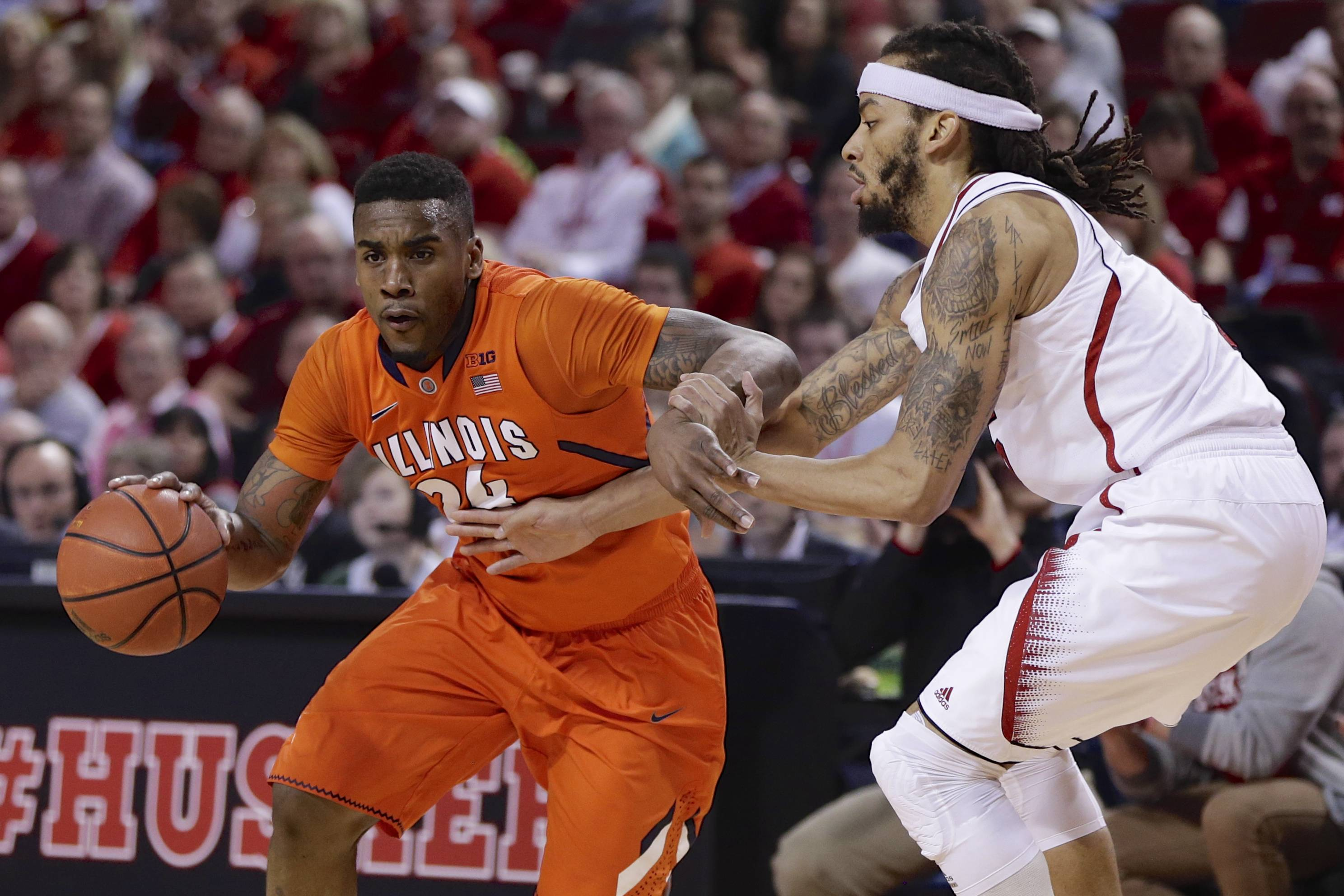 Nebraska's Terran Petteway, right, guards Illinois' Rayvonte Rice during Thursday night's game in Lincoln. The Huskers won 67-58.