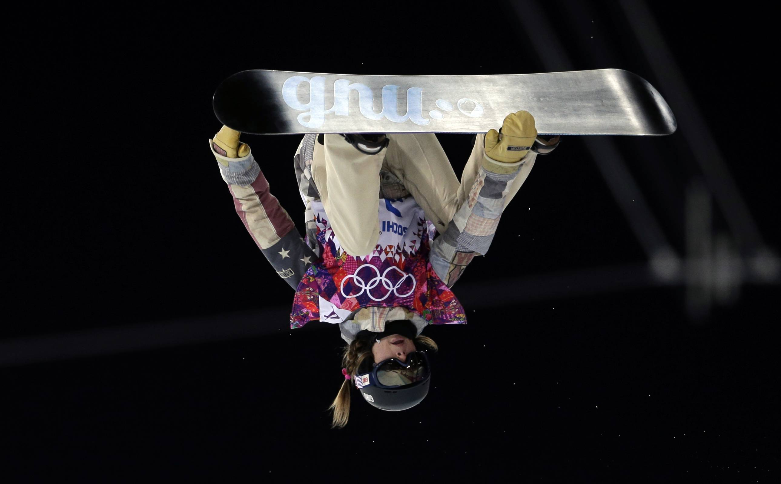 United States' Kaitlyn Farrington competes during the women's snowboard halfpipe final.