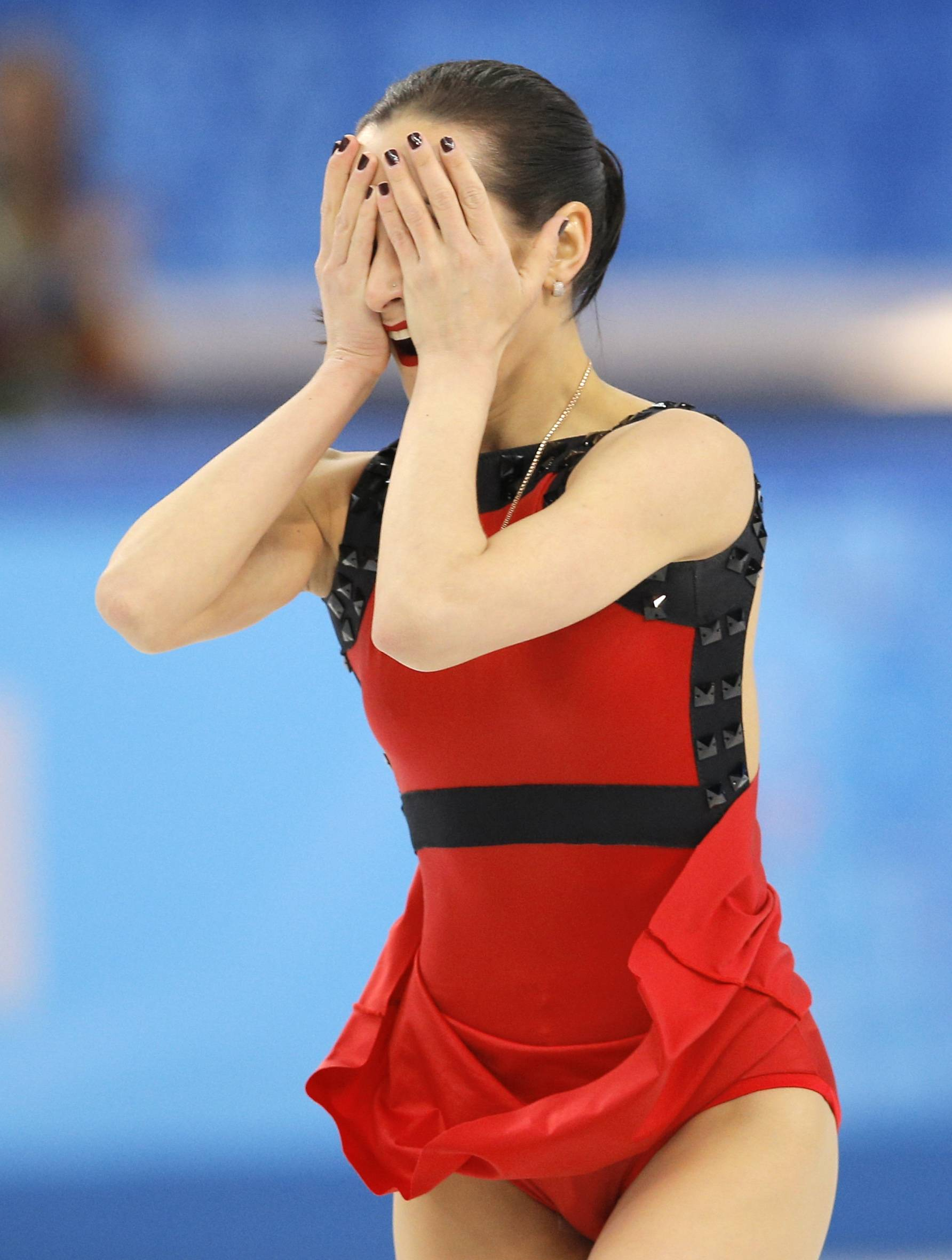 Ksenia Stolbova reacts as she and Fedor Klimov of Russia complete their routine in the pairs free skate figure skating.