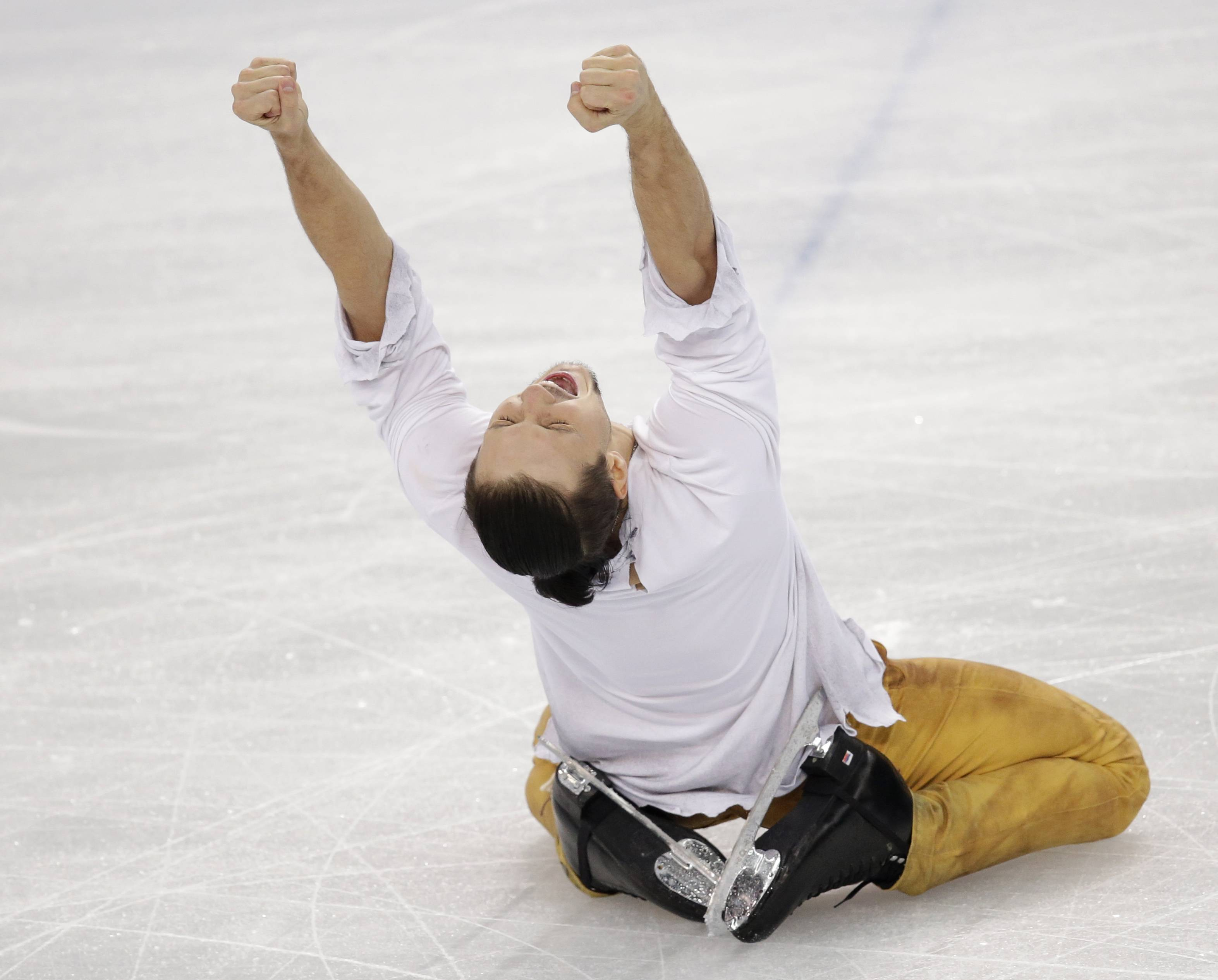 Fedor Klimov reacts after he and Ksenia Stolbova of Russia completed their routine in the pairs free skate figure skating.