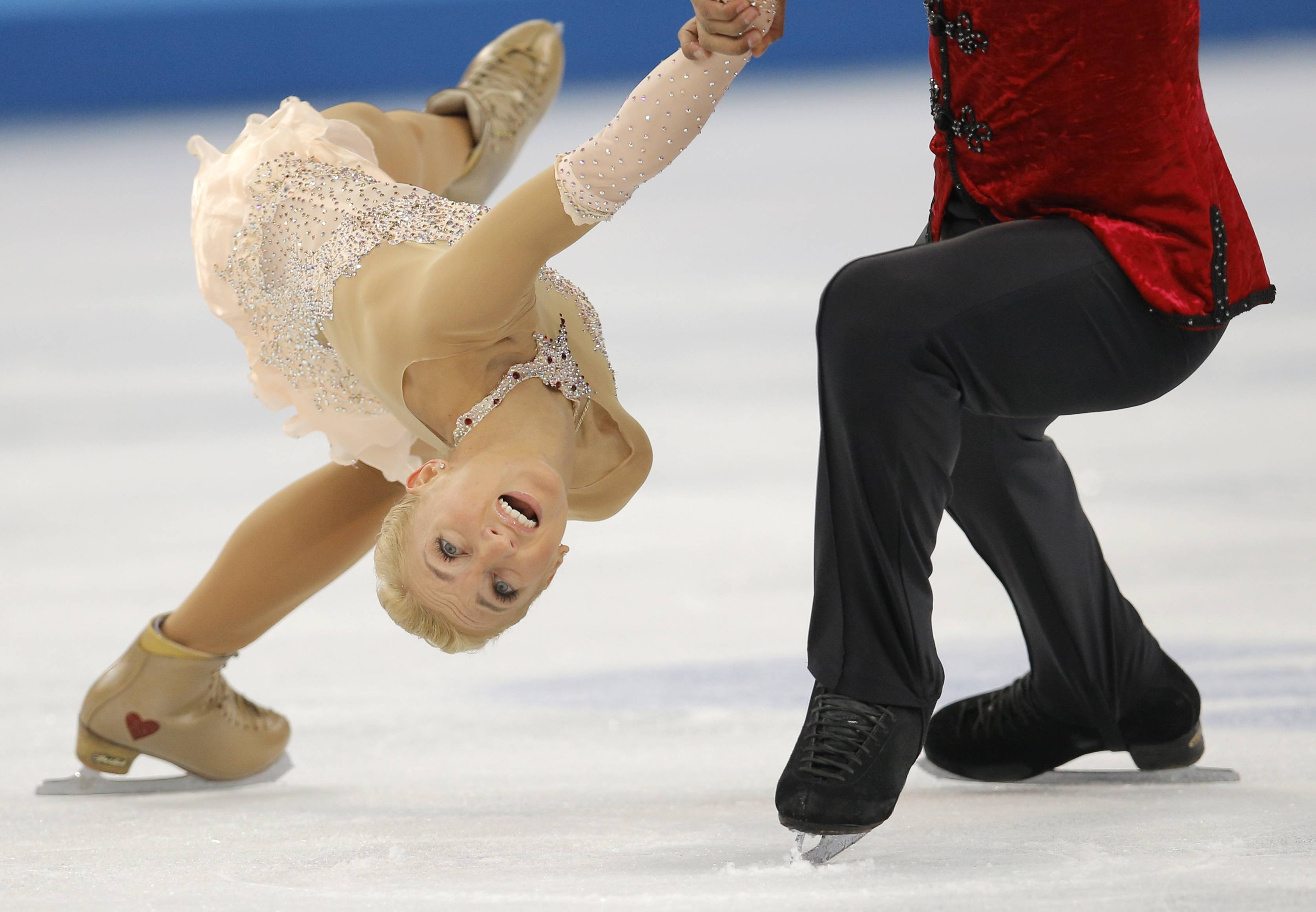Aliona Savchenko and Robin Szolkowy of Germany compete in the pairs free skate figure skating.