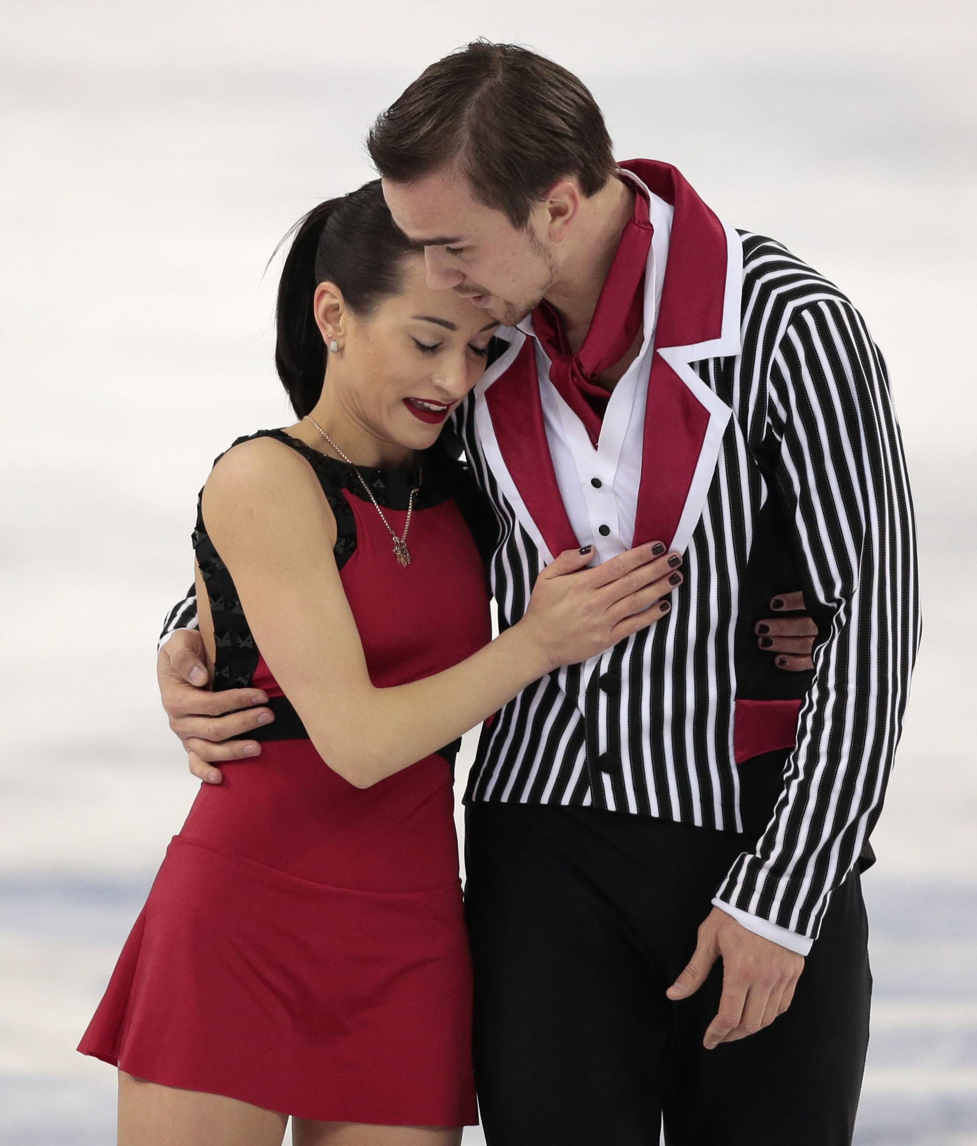 Ksenia Stolbova and Fedor Klimov of Russia embrace after competing in the pairs free skate figure skating.