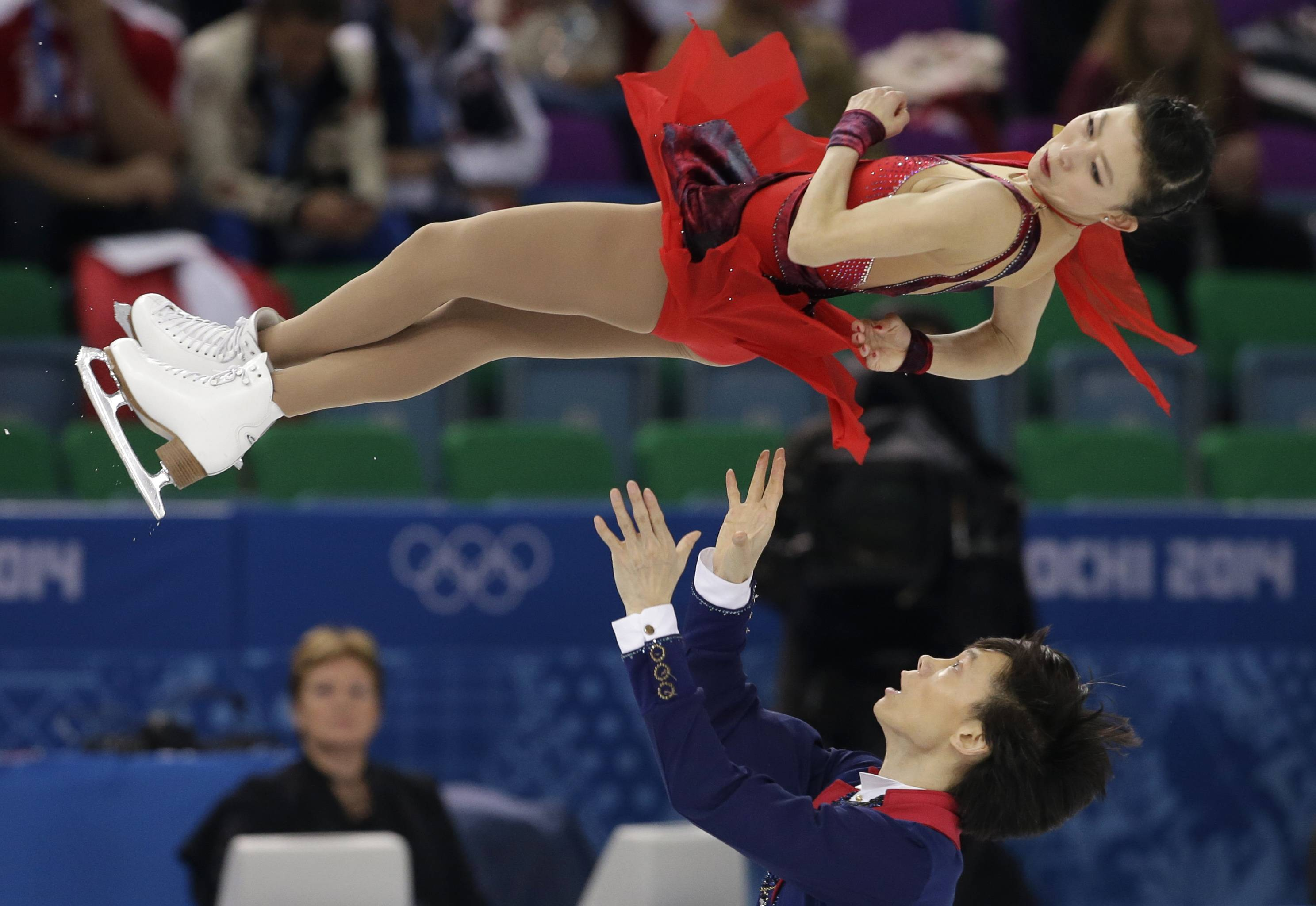 Pang Qing and Tong Jian of China compete in the pairs free skate figure skating competition.