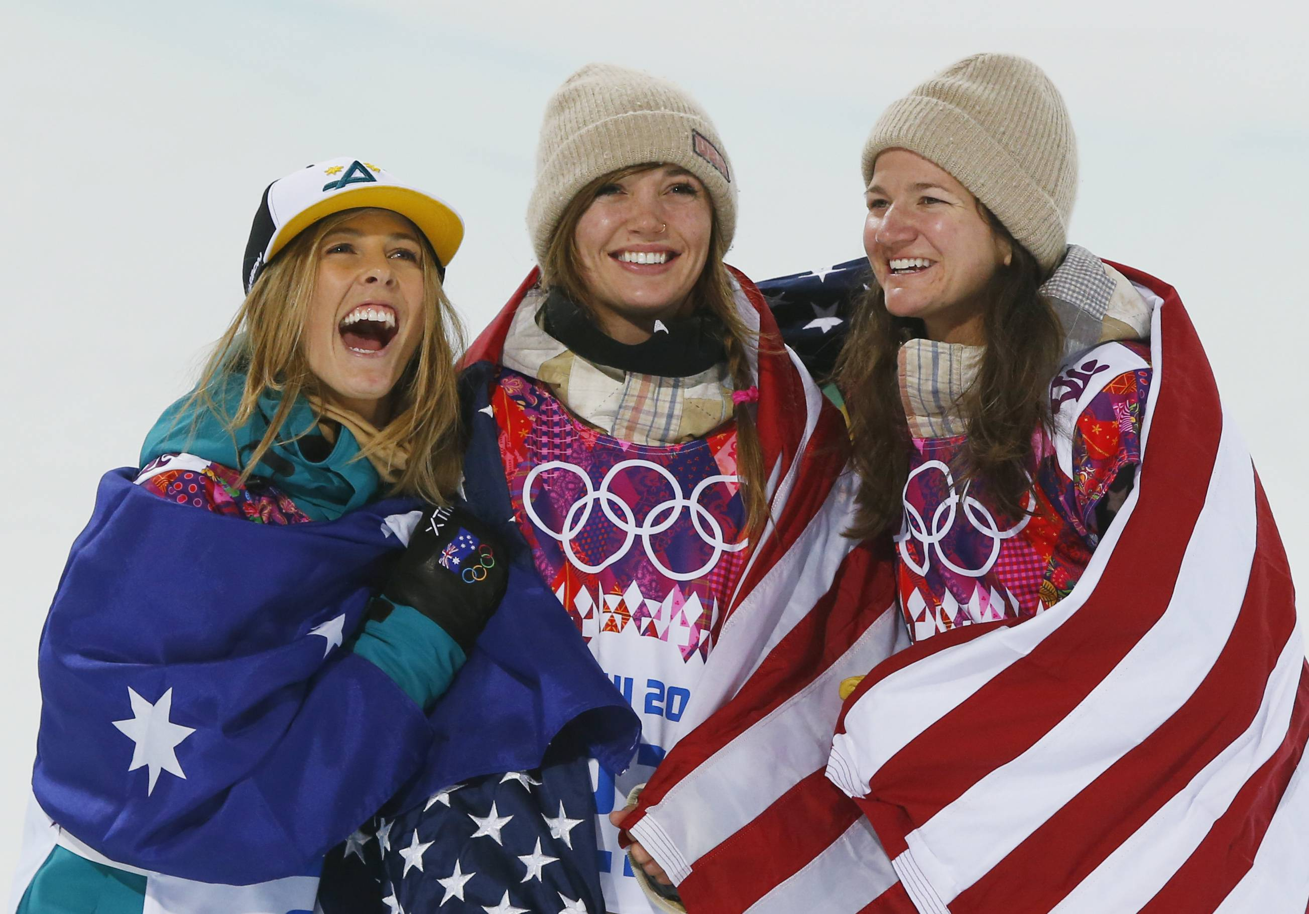 From left, silver medalist Australia's Torah Bright, gold medalist United States' Kaitlyn Farrington and bronze medalist United States' Kelly Clark pose following the women's snowboard halfpipe.