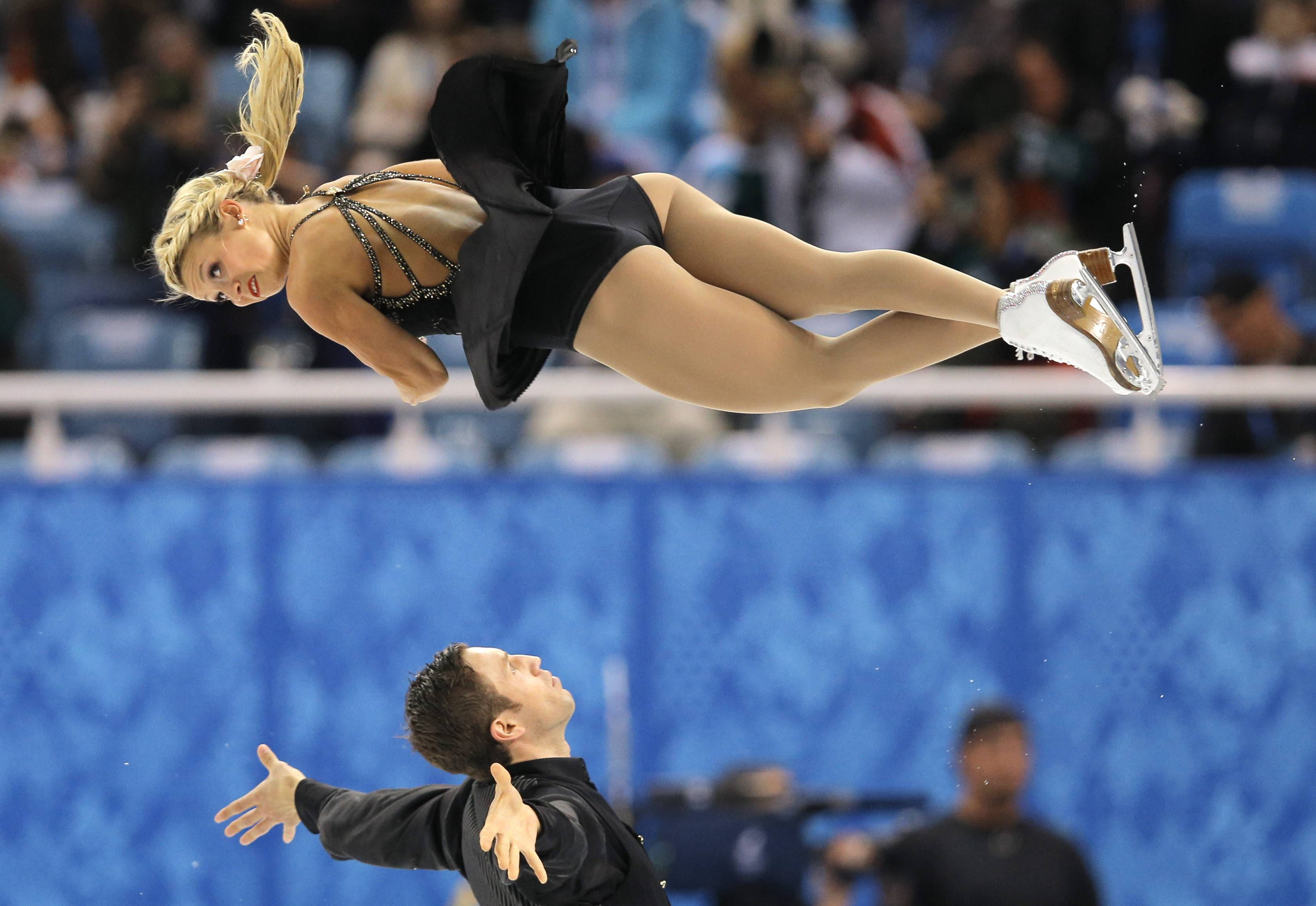 Kirsten Moore-Towers and Dylan Moscovitch of Canada compete in the pairs free skate figure skating competition.