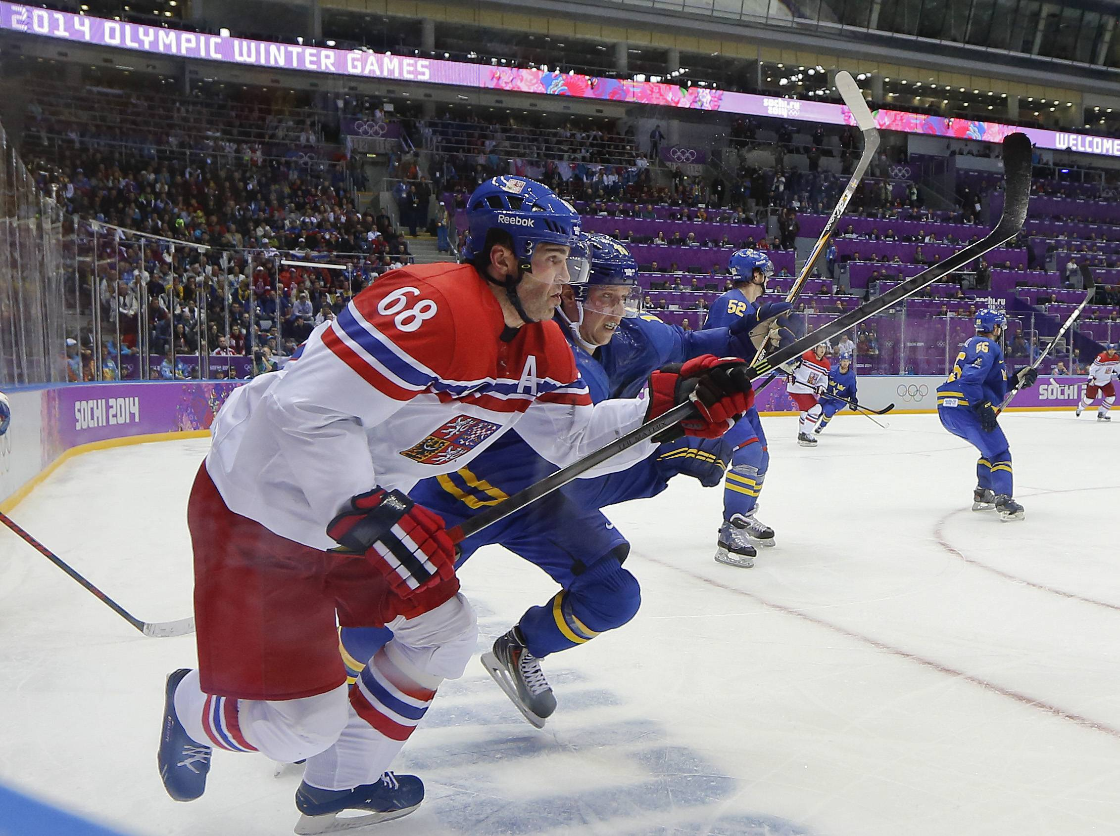 Czech Republic forward Jaromir Jagr and Sweden forward Loui Eriksson race after the puck in the third period.