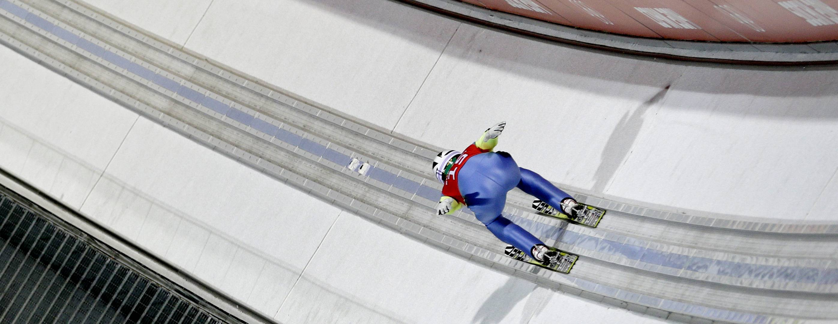 Kim Hyun-ki of South Korea speeds down the track during a men's ski jumping large hill training session.