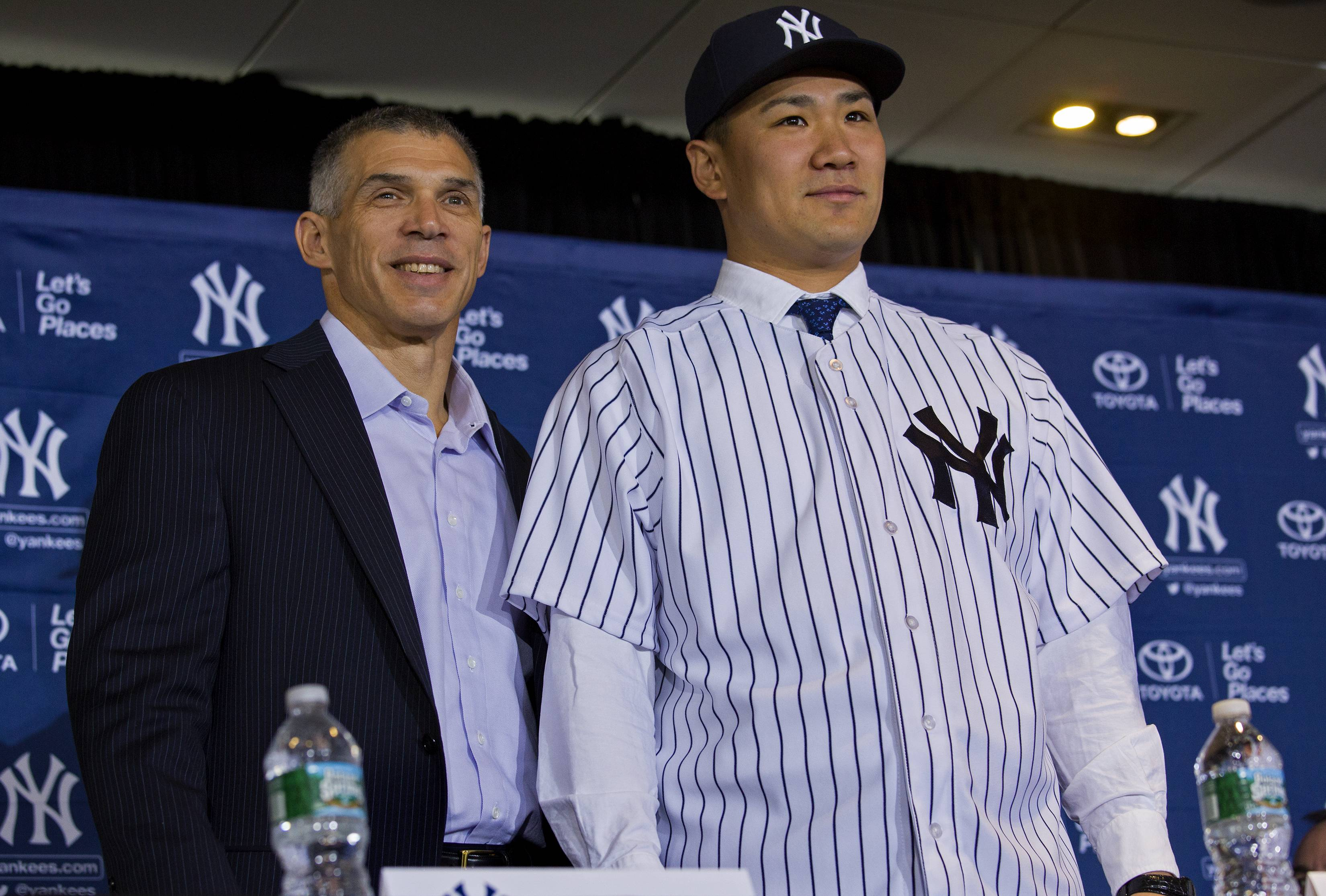 New York Yankees' pitcher Masahiro Tanaka, right, poses with New York Yankees manager Joe Girardi as he was introduced to the media at Yankee Stadium in New York Tuesday, Feb. 11, 2014. AP Photo/Craig Ruttle)