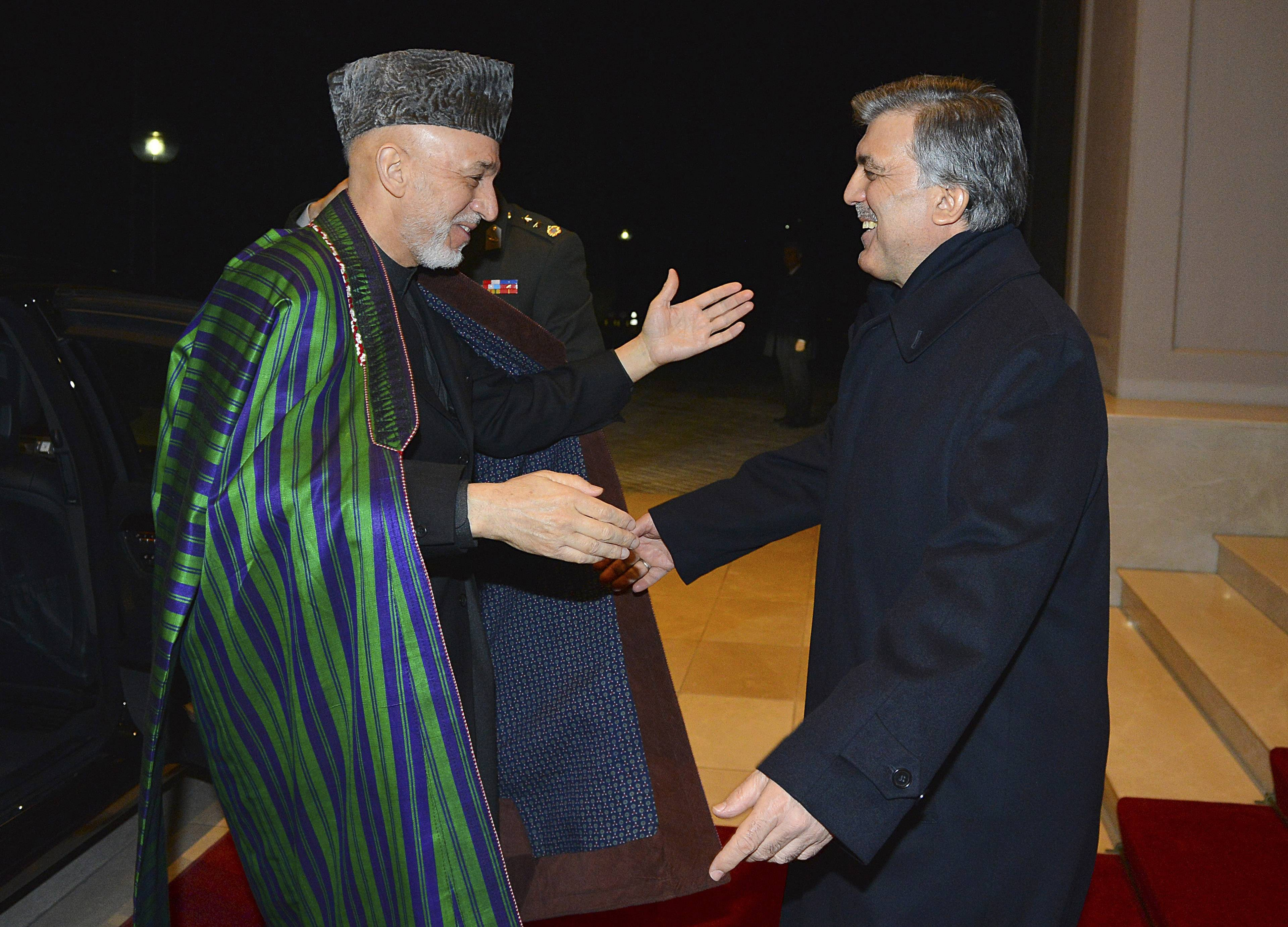 In this photo taken late Wednesday, Turkish President Abdullah Gul, right, greets his Afghan counterpart, President Hamid Karzai, in Ankara, Turkey.