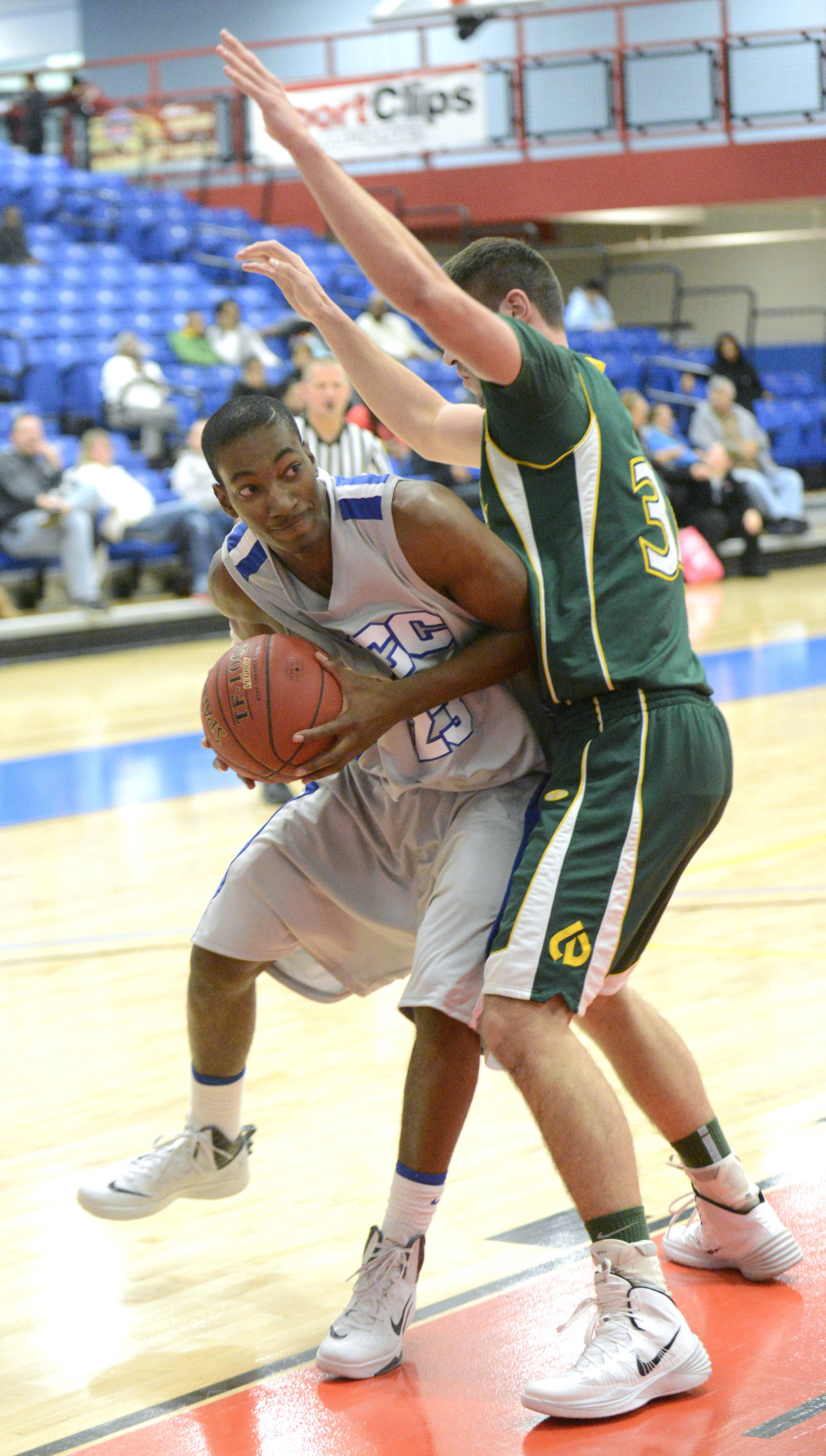 Elgin Community College's Zach Cooper makes his way around a block by College of DuPage's Ryan Rader during a game in Elgin last season.