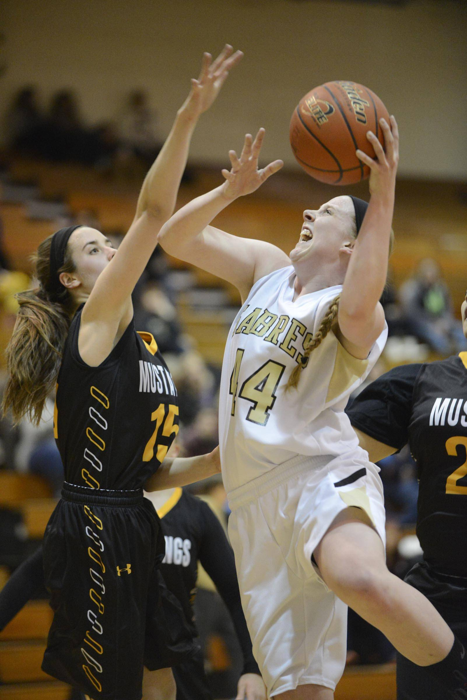 Streamwood's Hannah McGlone shoots around Metea Valley's Jenny Voytell Thursday in Streamwood.
