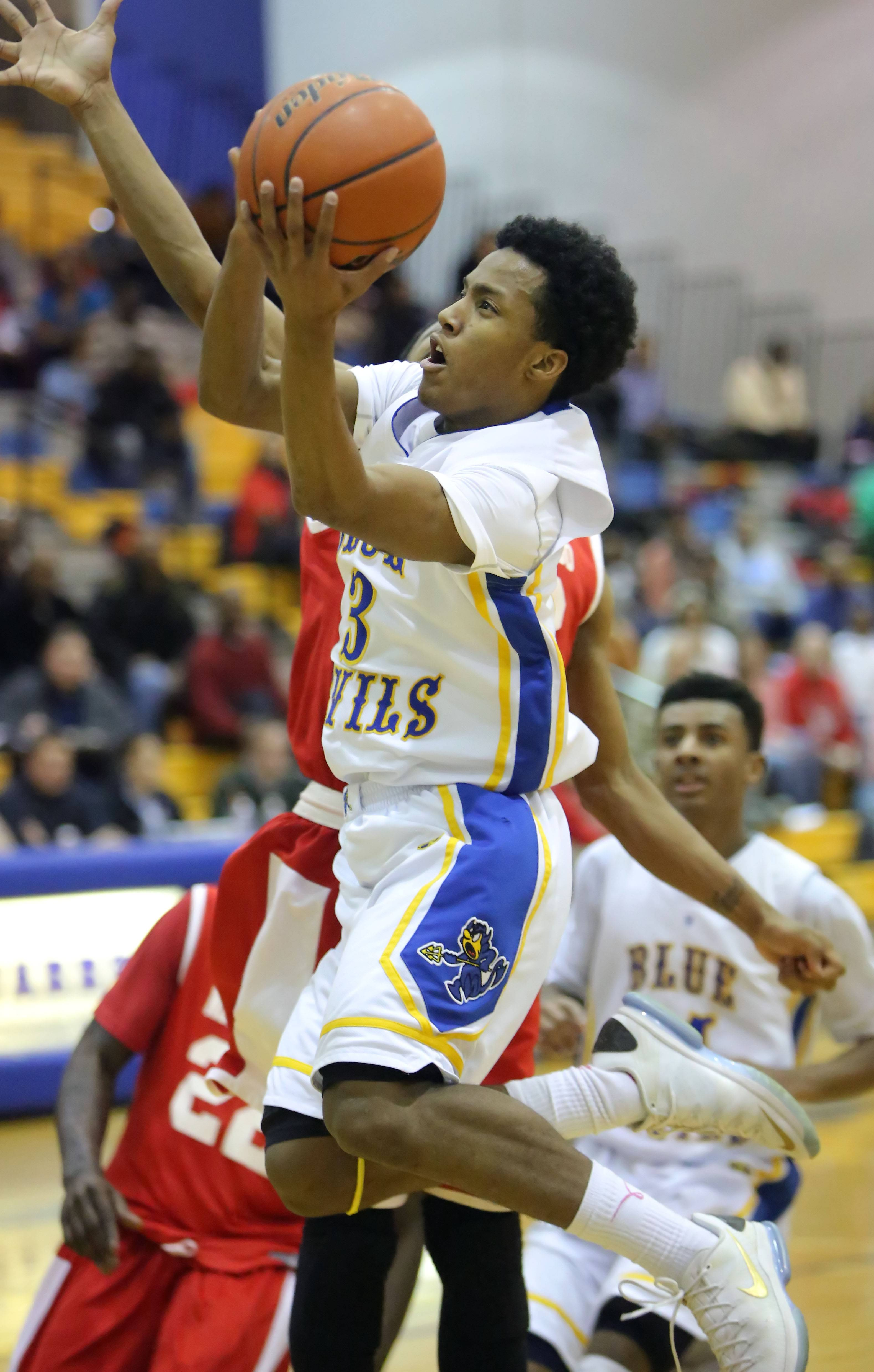 Warren's Eric Gillespie drives to the hoop during the Blue Devil's game against North Chicago on Tuesday night.