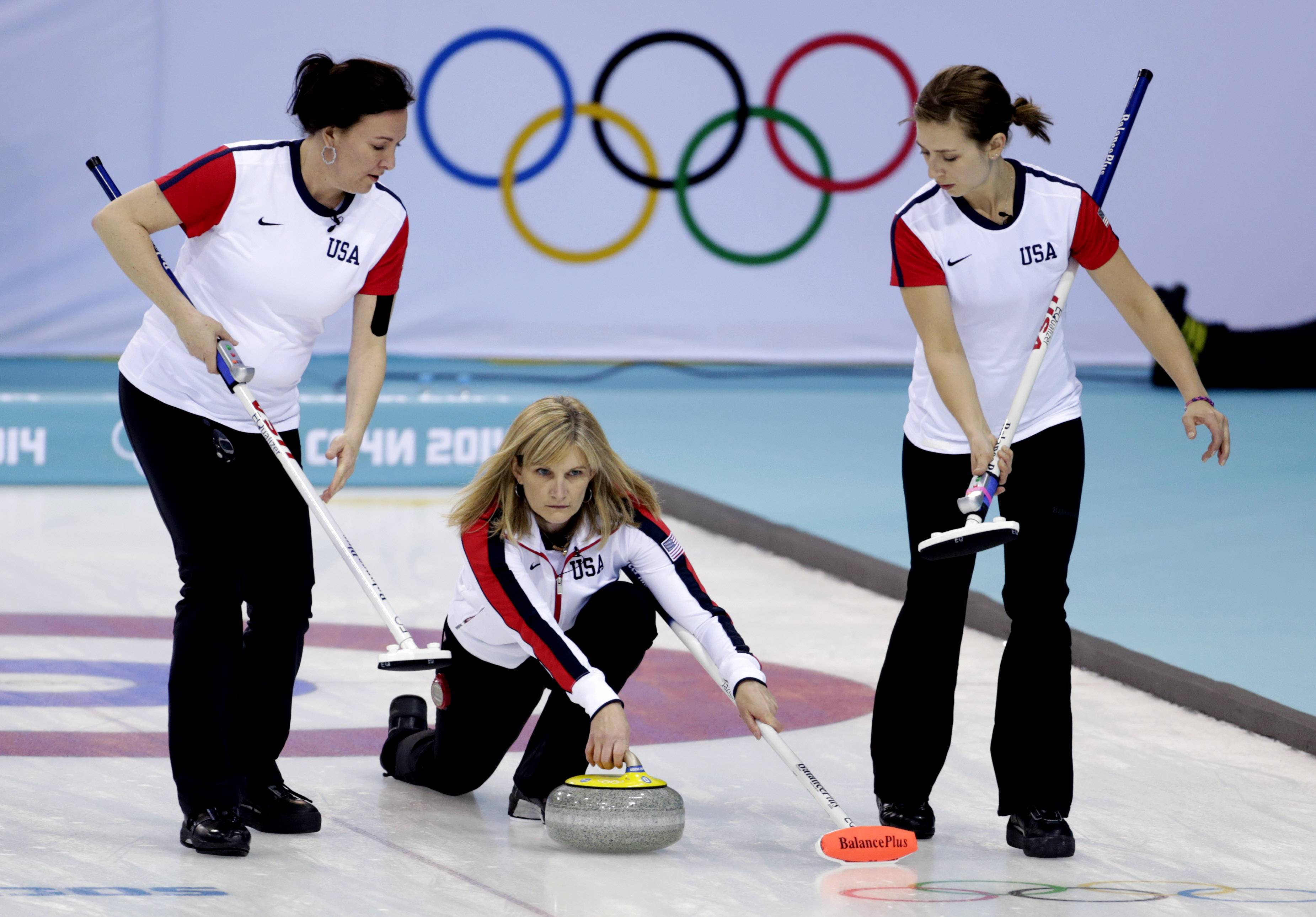 Nothing says Winter Olympics quite like curling as Erika Brown, skip of the United States team, middle, delivers the rock to her sweepers Ann Swisshelm, left, and Jessica Schultz during women's curling competition against Japan on Thursday.