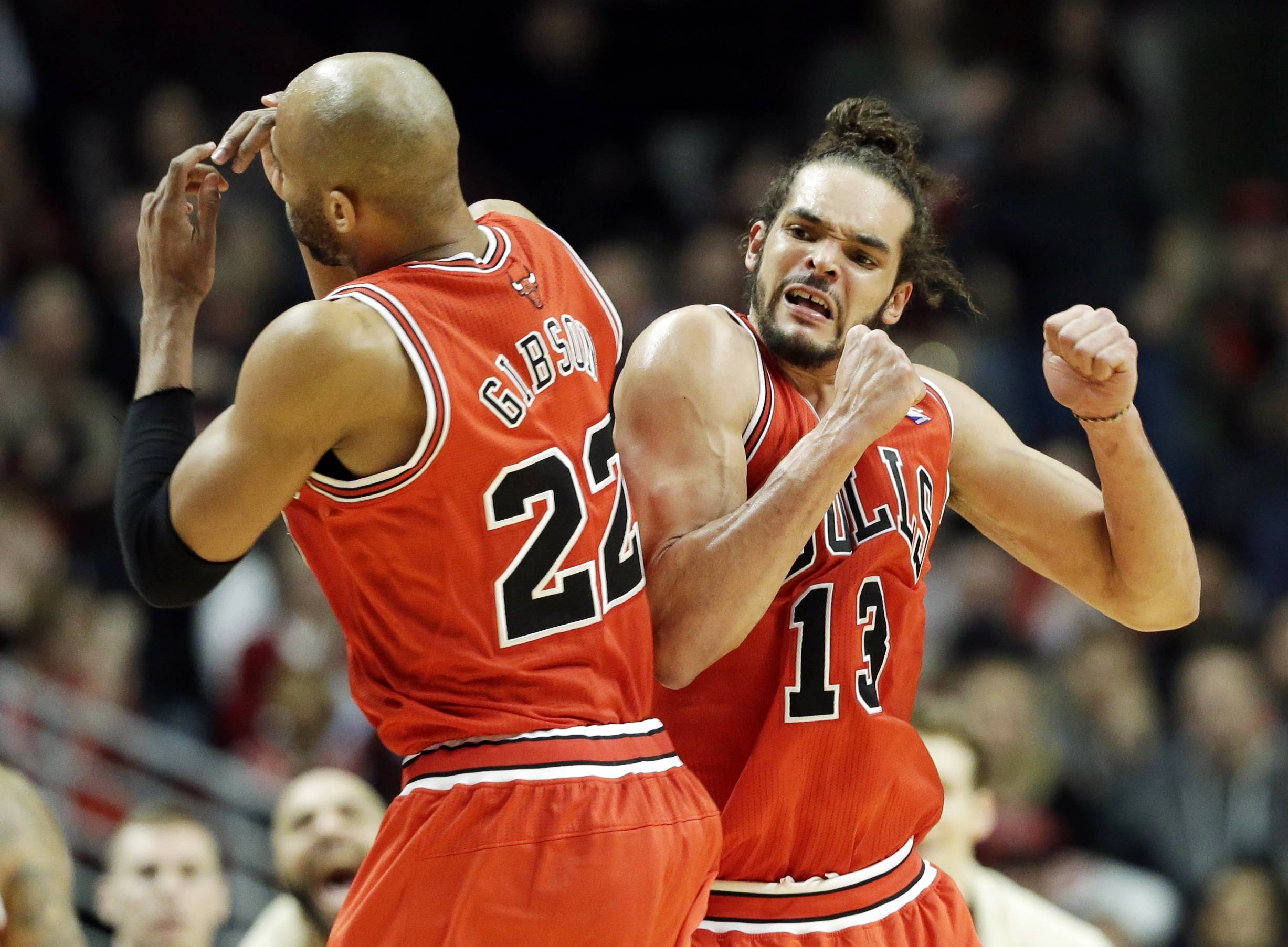 Chicago Bulls center Joakim Noah, right, celebrates with Taj Gibson after Gibson scored a basket during the second half of a game against the Brooklyn Nets Thursday night at the United Center. The Bulls won 92-76.