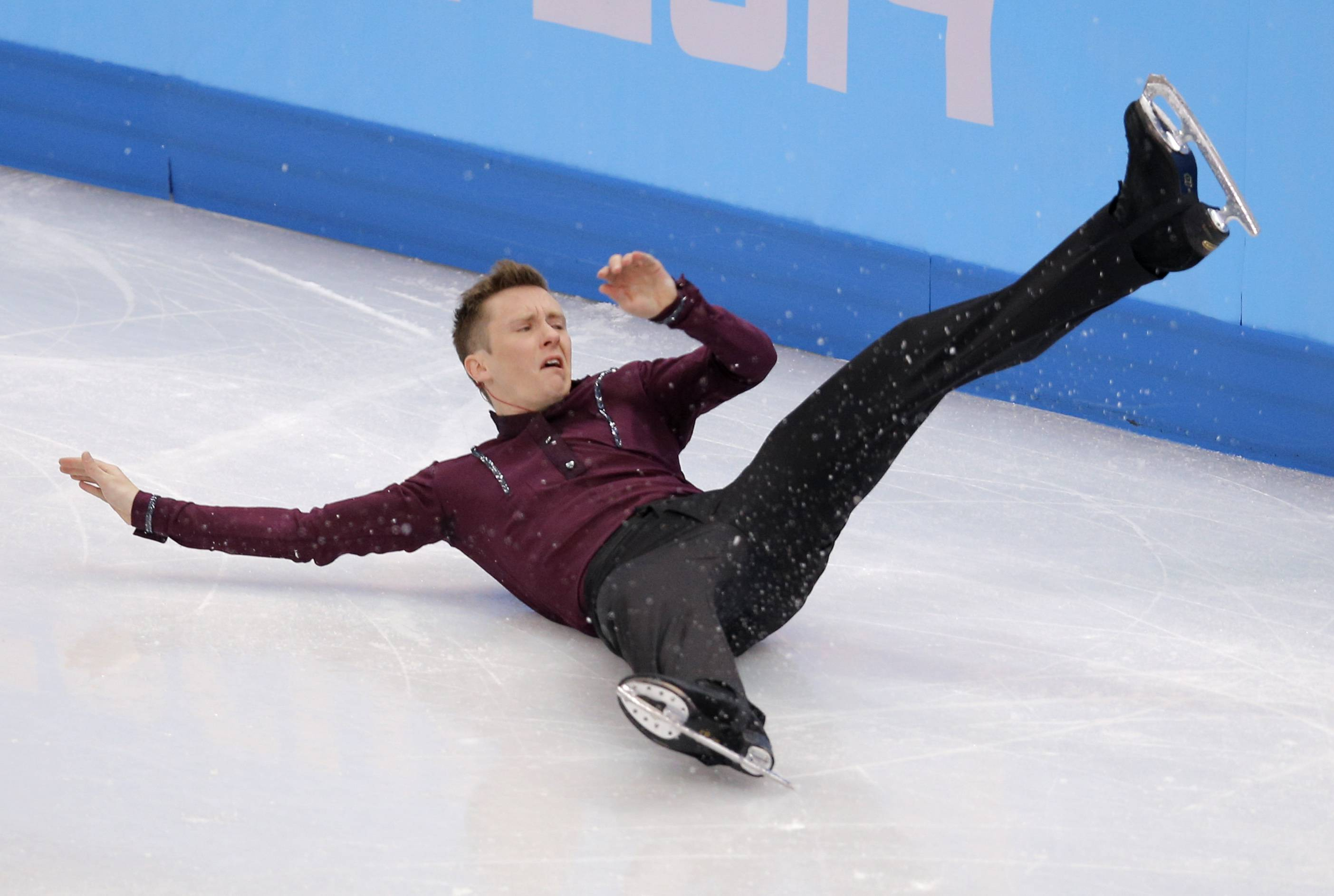 Jeremy Abbott of the United States crashed to the ice on his first jump and slid into the padded end boards, staying down for an extended period,