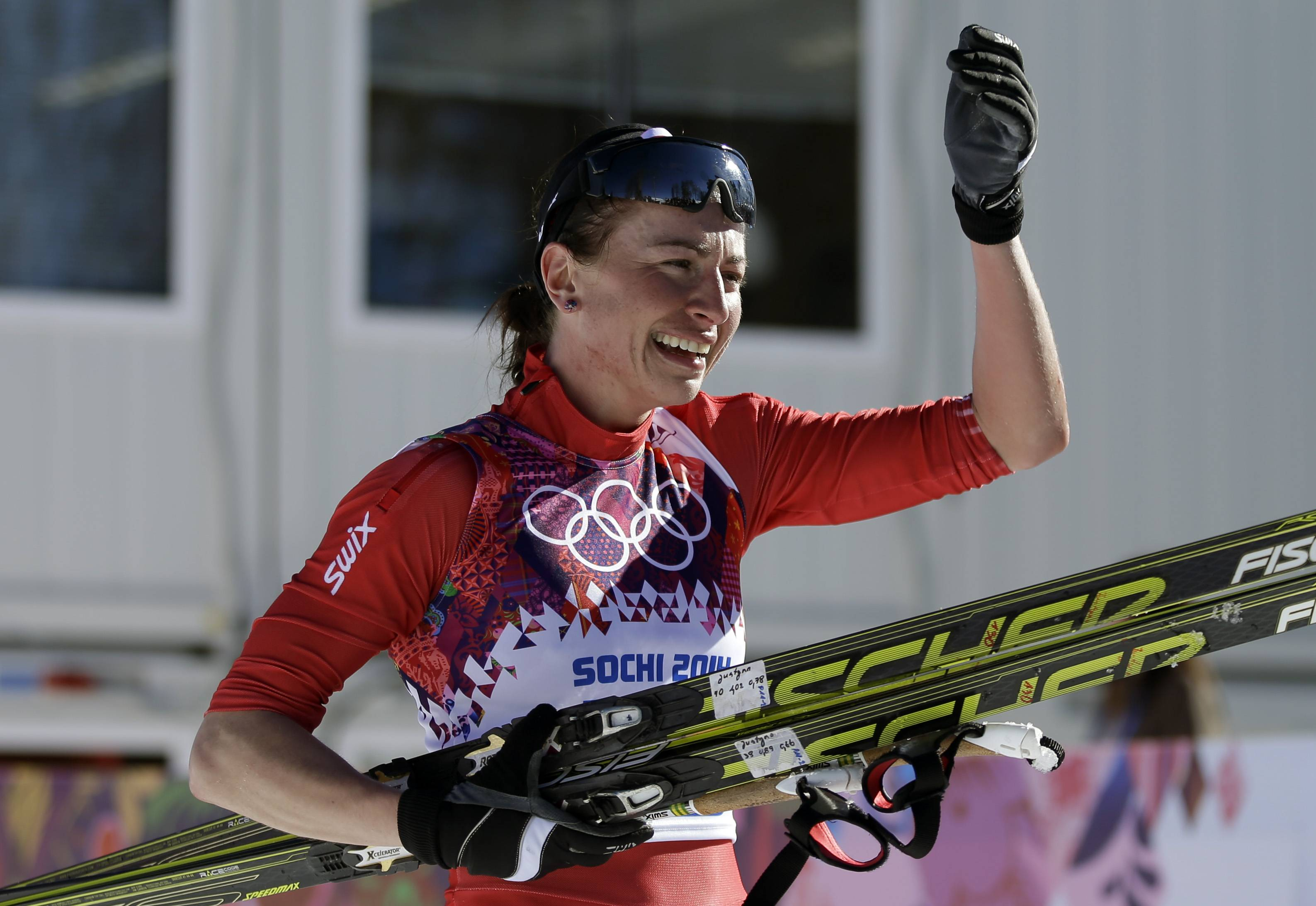 Poland's Justyna Kowalczyk celebrates Thursday after winning the women's 10K classical-style cross-country race at the 2014 Winter Olympics in Krasnaya Polyana, Russia.
