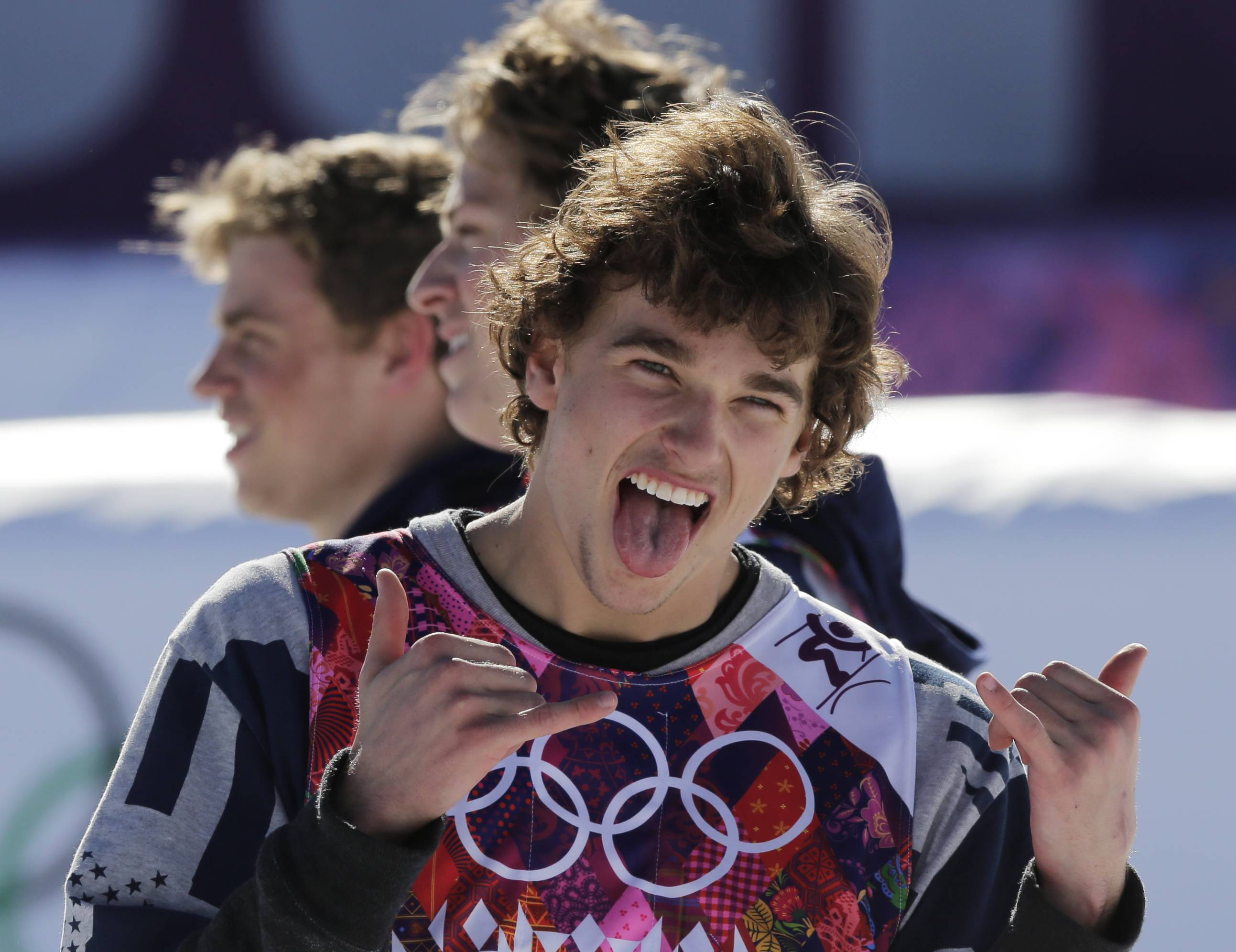 Nicholas Goepper of the United States celebrates his bronze medal Thursday in men's slopestyle skiing at the Rosa Khutor Extreme Park at the 2014 Winter Olympics in Krasnaya Polyana, Russia. Behind him are teammates Gus Kenworthy, left, who won silver, and Joss Christensen, who won gold.